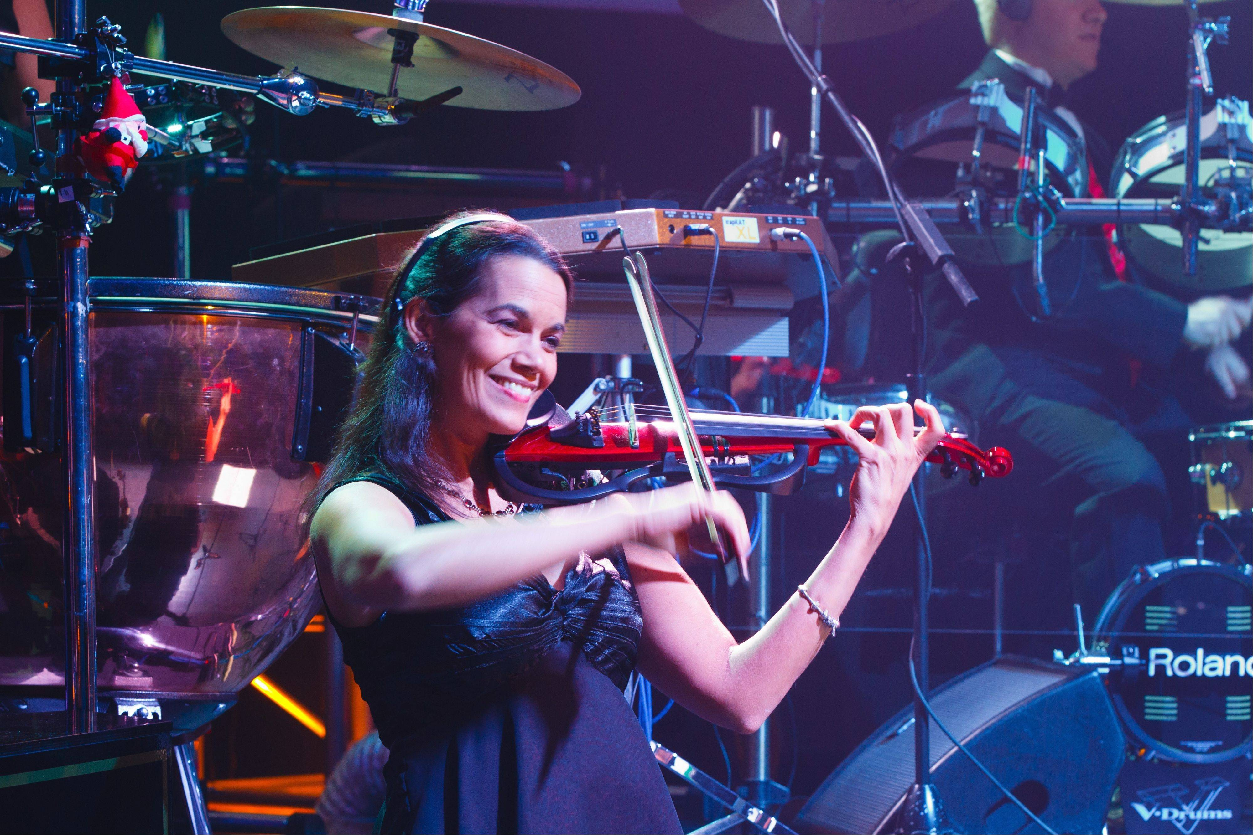 Becky Kia, who grew up in Lombard, is the violin soloist with the popular Christmas group, Mannheim Steamroller.