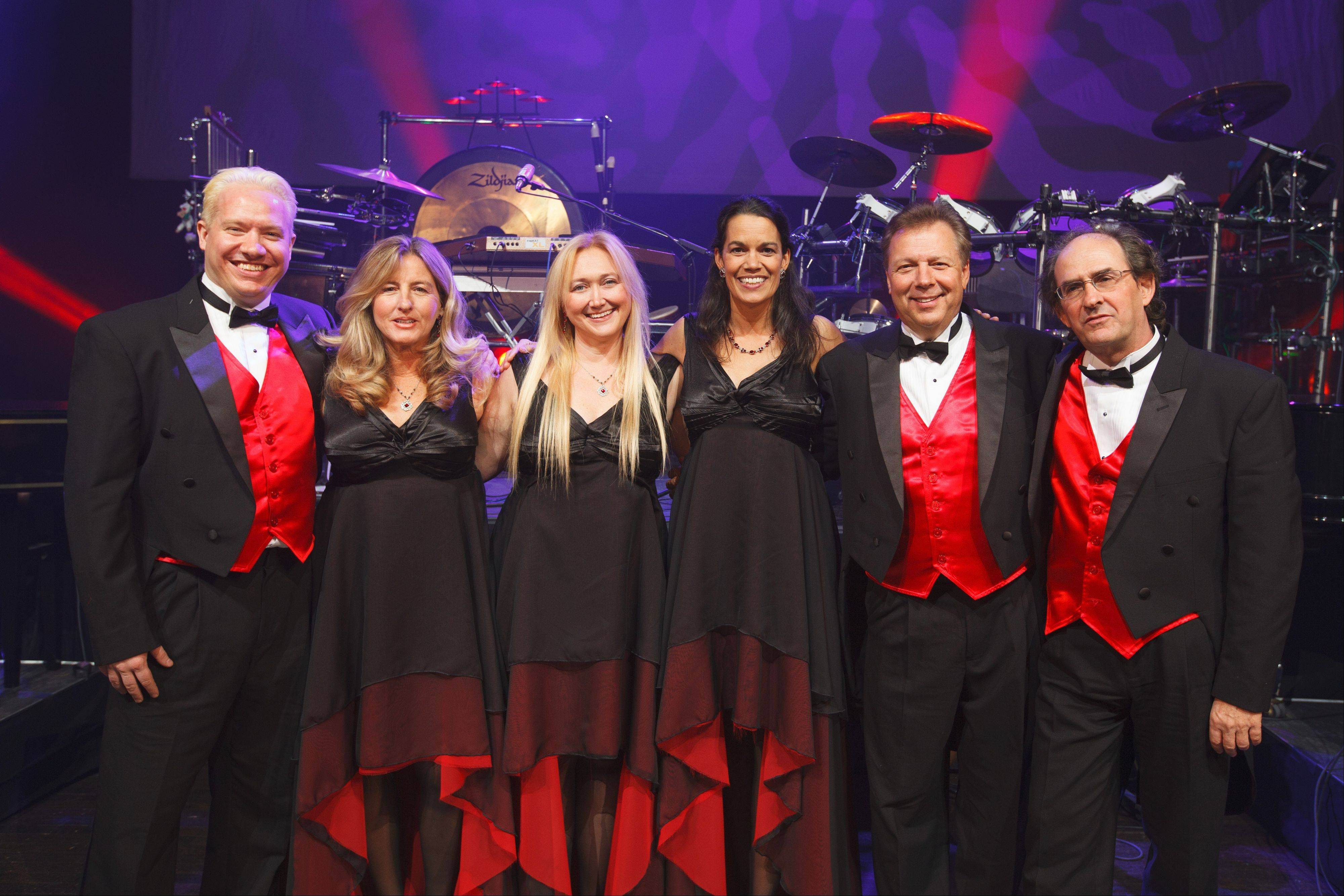 "Members of Mannheim Steamroller's ""green"" band, from left to right, are Logan Penington, Roxanne Layton, Christy Crowl, Lombard native Becky Kia, Ron Cooley and Curtis McKonly."