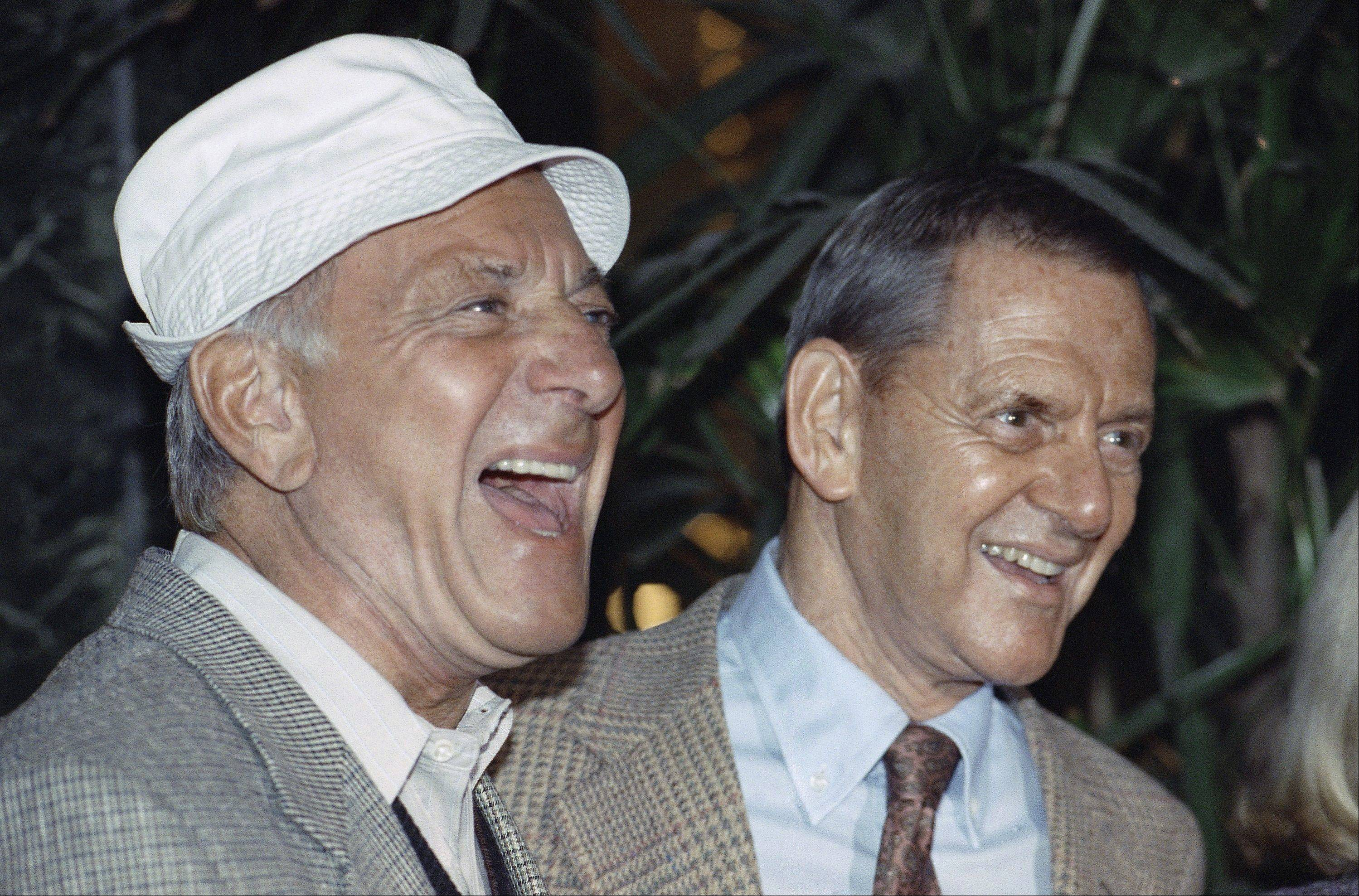 "In this Dec. 3, 1992 file photo, Jack Klugman, left, and Tony Randall laugh at a news conference announcing that they will reprise their most famous roles as Oscar Madison and Felix Unger respectively, for a one-night benefit performance of Neil Simons play, ""The Odd Couple"", in Beverly Hills, Calif. Klugman, the prolific, craggy-faced character actor and regular guy who was loved by millions as the messy one in TV's ""The Odd Couple"" and the crime-fighting coroner in ""Quincy, M.E.,"" died Monday, a son said. He was 90."