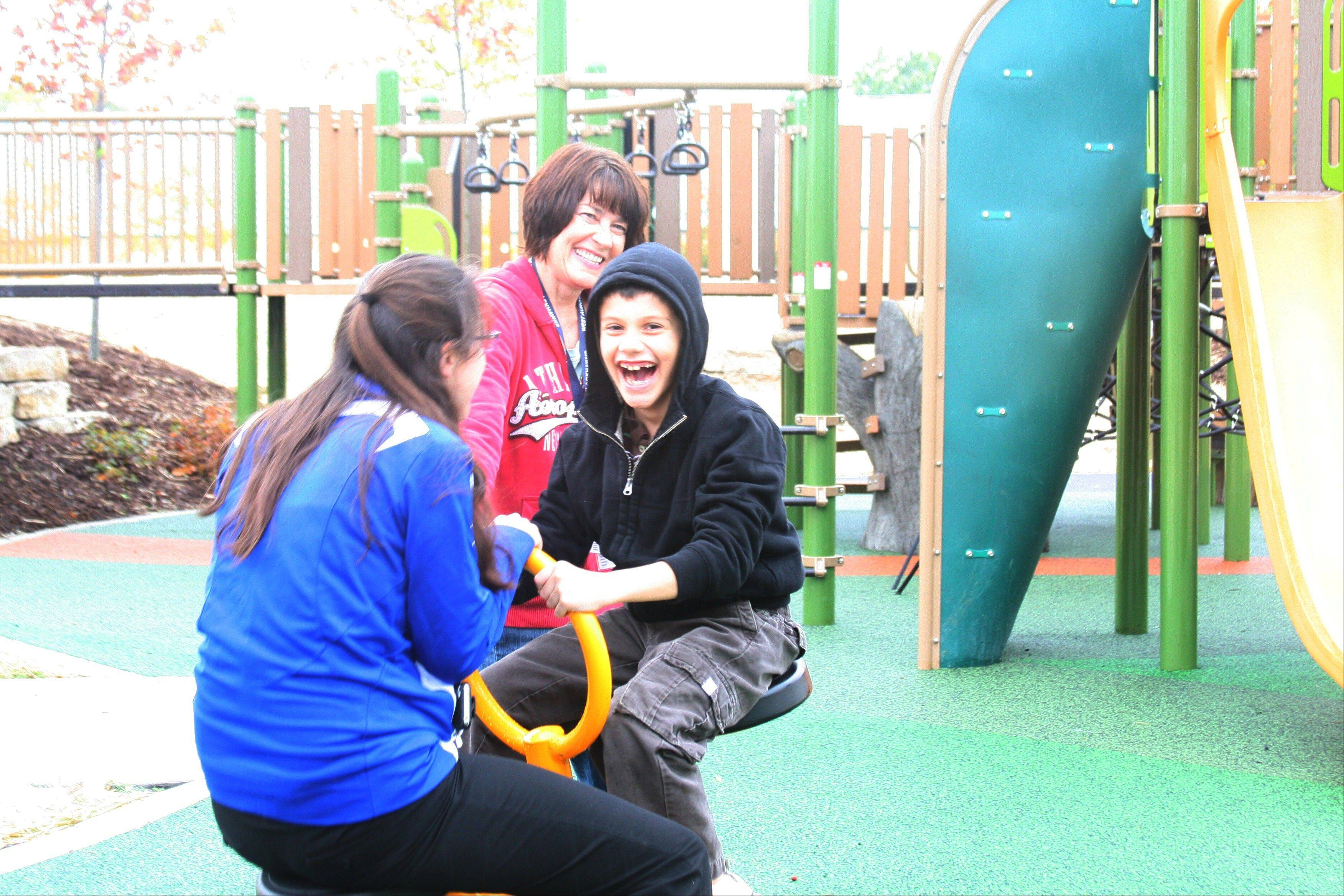Park users enjoy playground equipment at Harmony Pointe, a new park added north of the Vaughan Athletic Center.