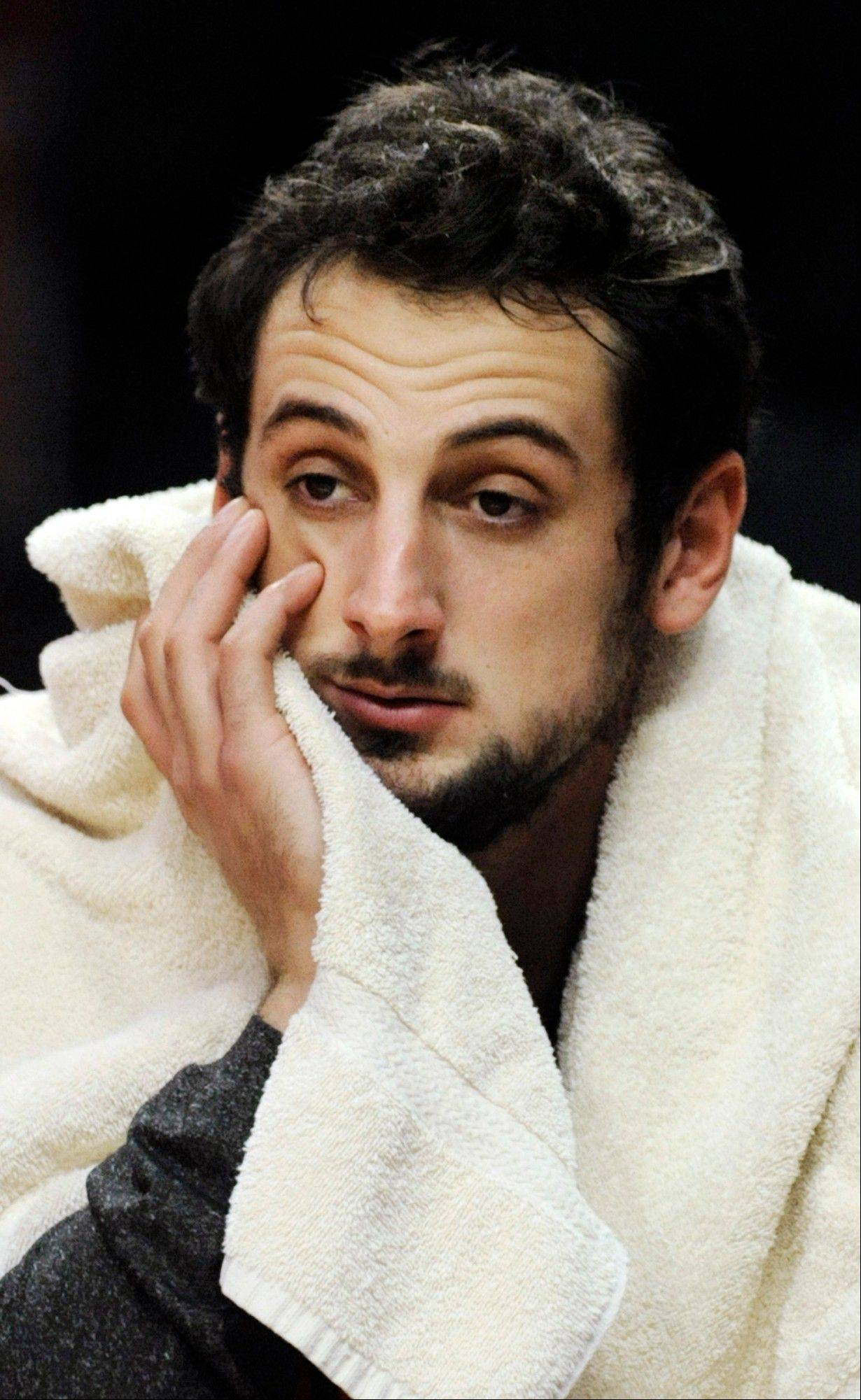 The Bulls' Marco Belinelli watches from the bench Tuesday during the final seconds of the fourth quarter against the Houston Rockets at the United Center. Houston won 120-97.