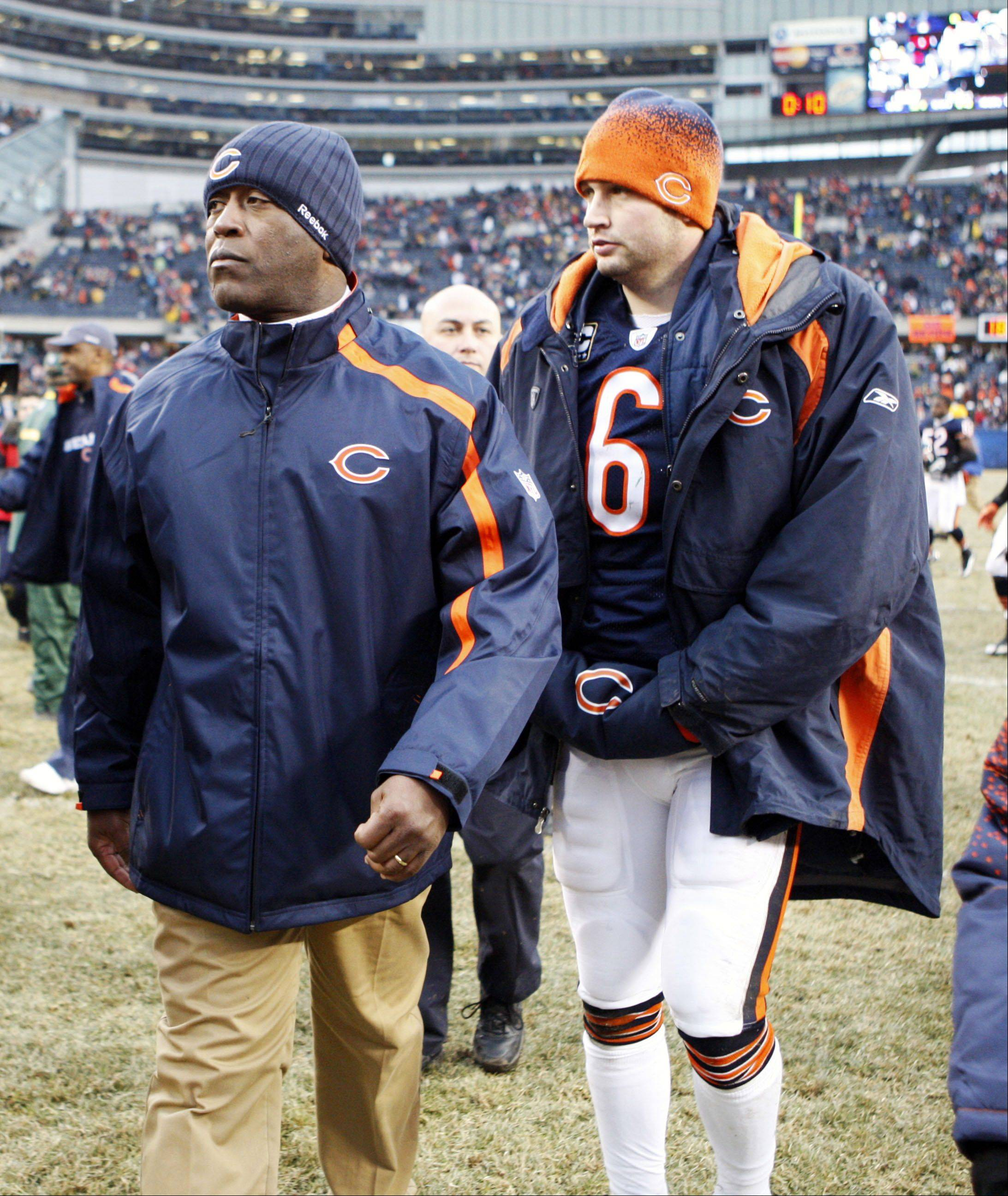 Coach Lovie Smith, left, and quarterback Jay Cutler have plenty on the line when the Bears travel to Detroit for the regular-season finale Sunday.