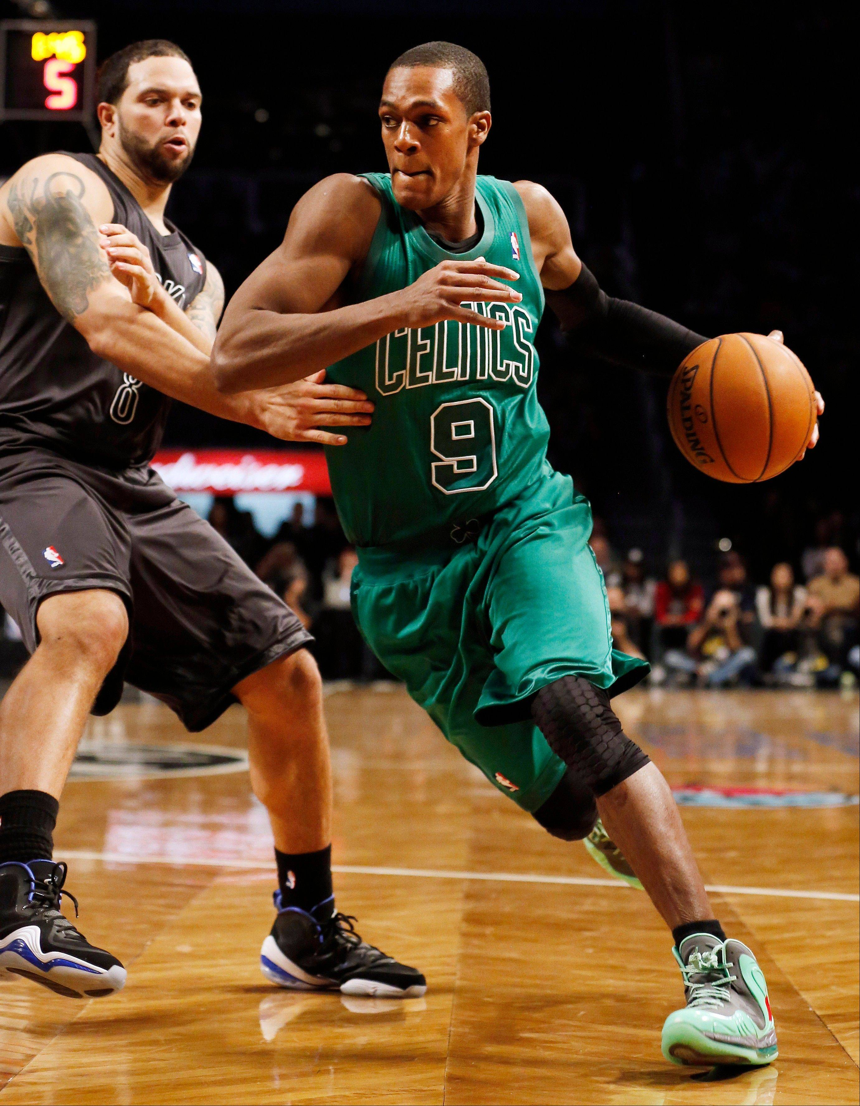 Boston Celtics guard Rajon Rondo drives to the basket against Brooklyn Nets guard Deron Williams Tuesday during the second half at Barclays Center in New York. Boston won 93-76.