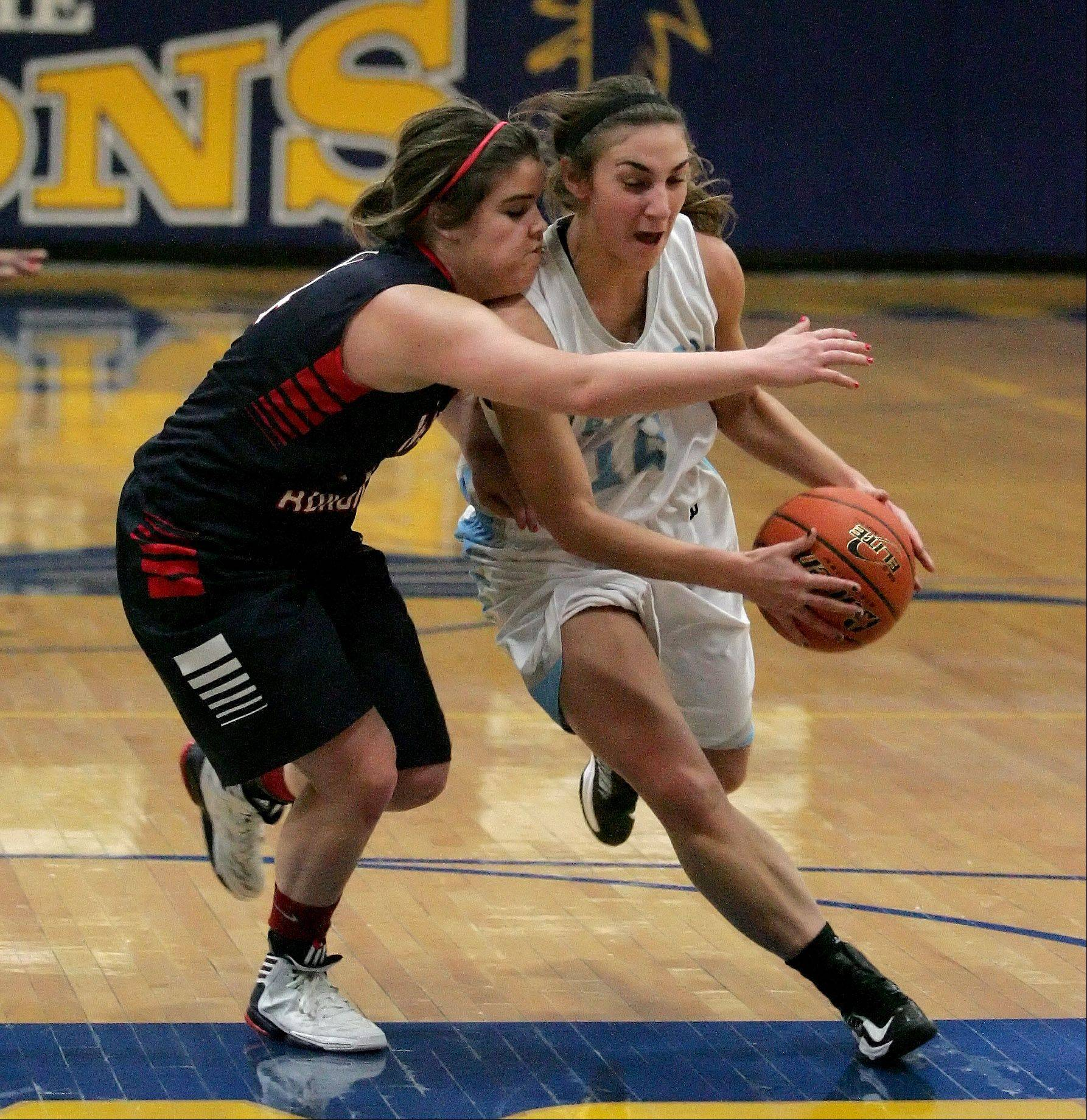 Angela Bruno, right, of Willowbrook drives the ball around Erin Jacobsen of West Aurora in girls basketball action at the 2012 Bill Neibch Holiday Tournament at Wheaton North High School on Wednesday.