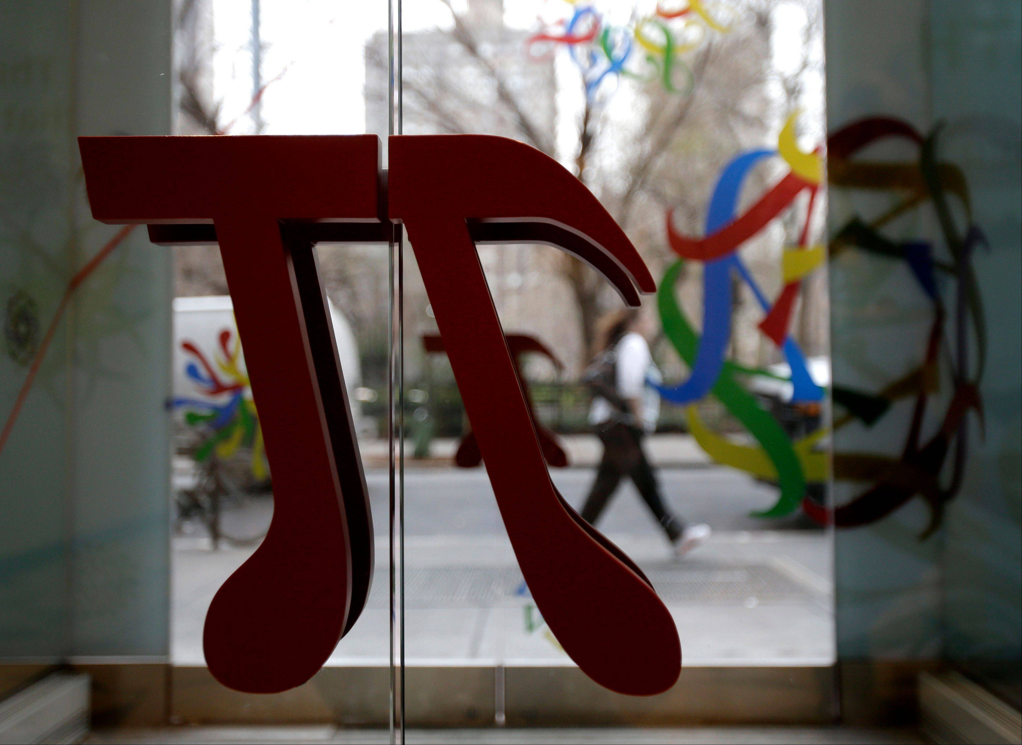 A door handle in the shape of pi is seen at the new National Museum of Mathematics in New York. The museum is aimed at kids aged 8 to 13, and curators have given the place a playground feel.