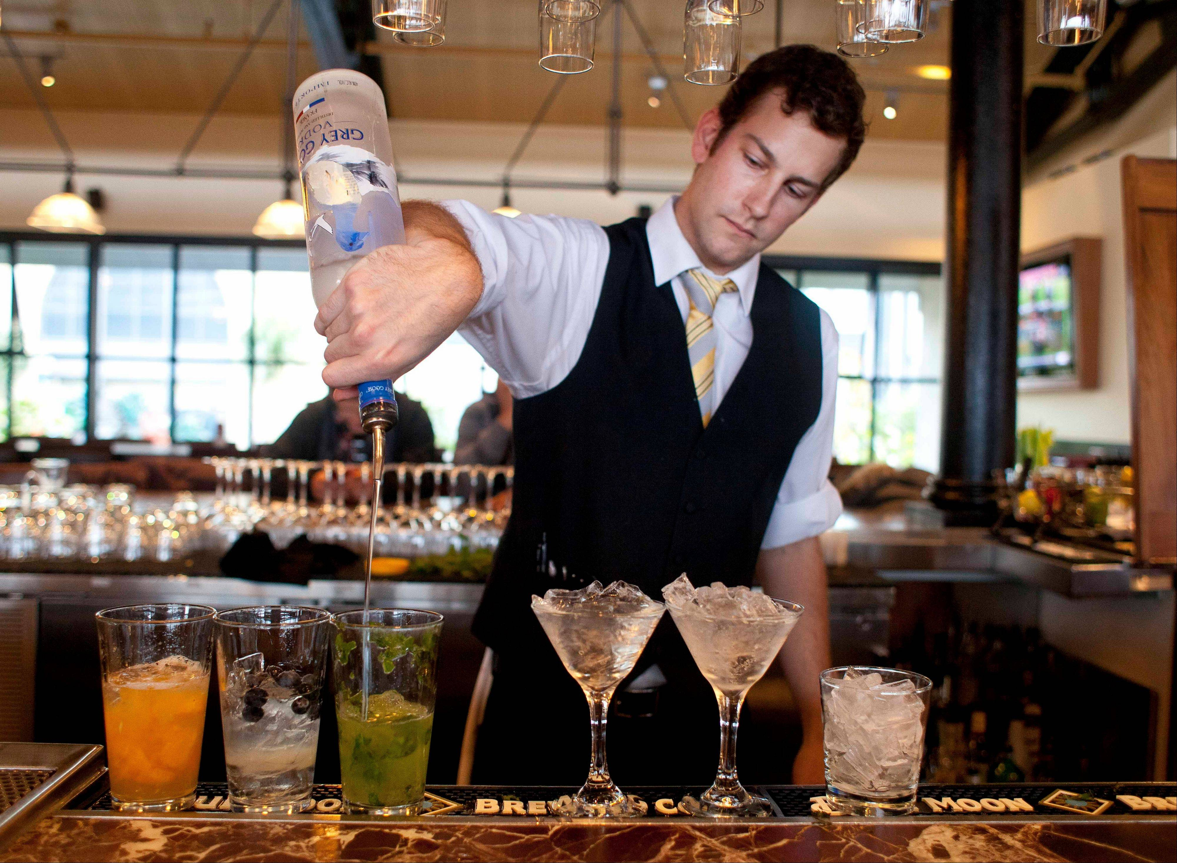 Bartender Nico Reynders makes three different drinks from vodka at the Bistro Boudin in San Francisco.