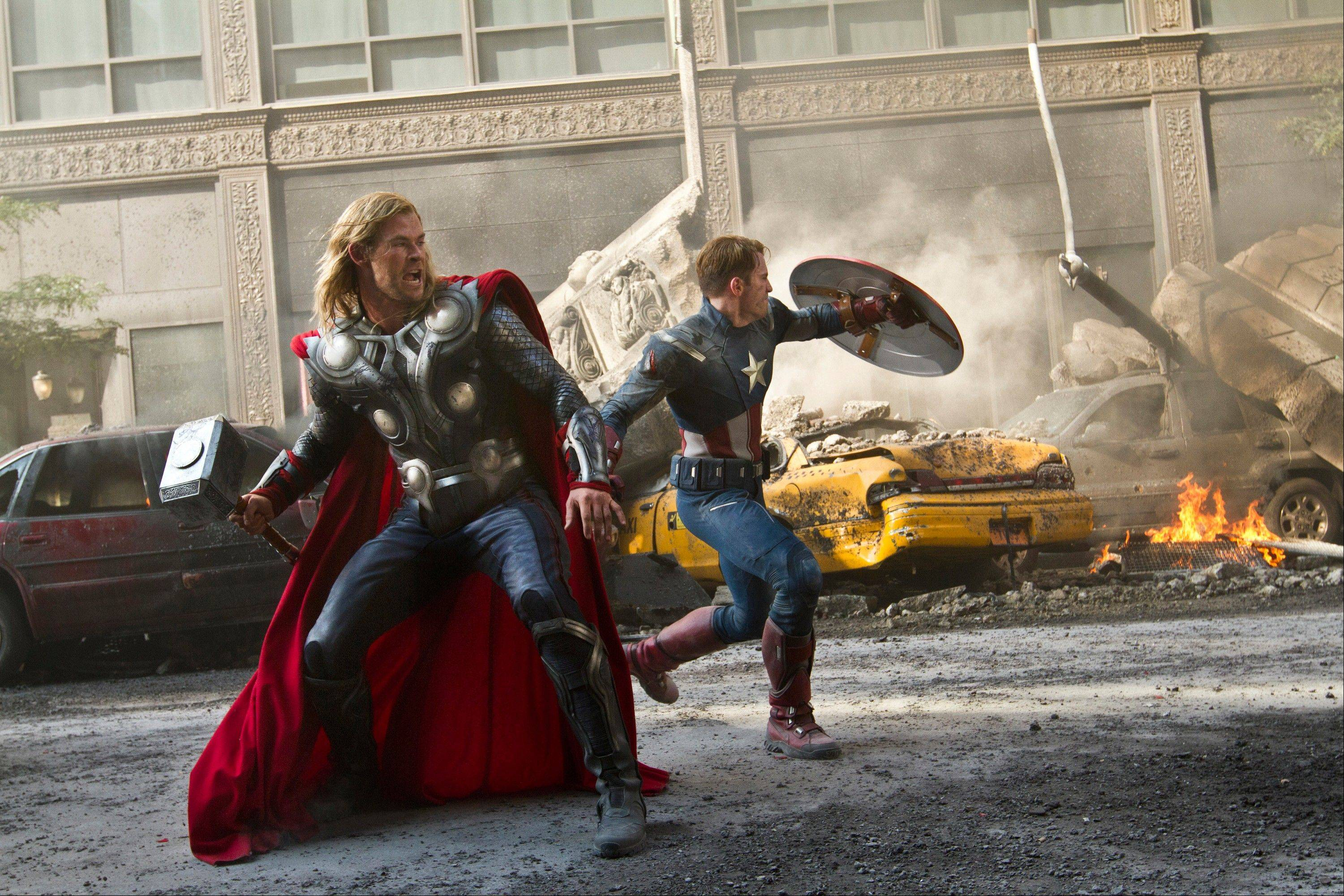 "Chris Hemsworth as Thor, left, and Chris Evans as Captain America, in ""The Avengers."""