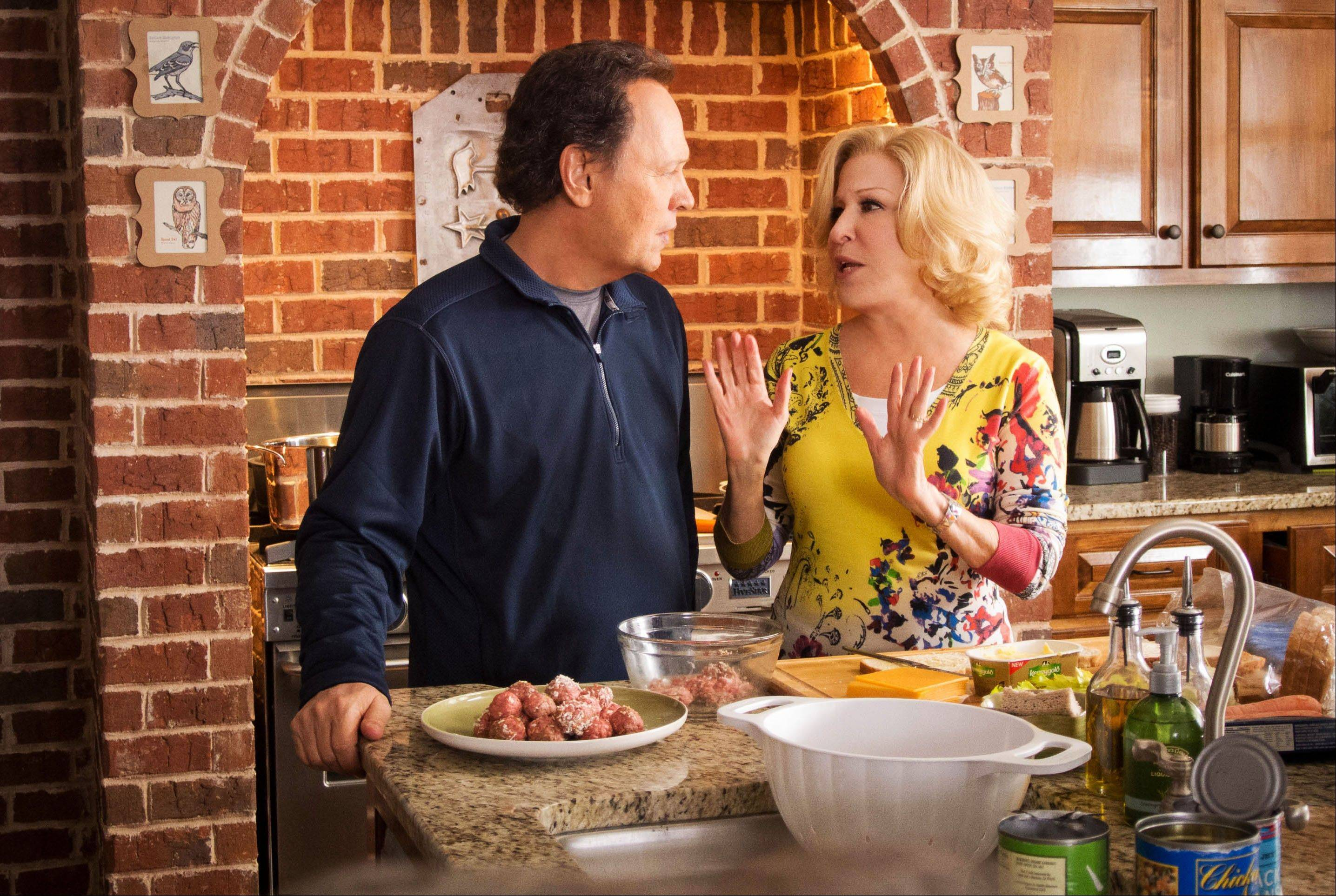 "Artie Decker (Billy Crystal) and his wife, Diane, (Bette Midler) debate whether to accept their daughter's invitation to baby sit their grandkids in the film ""Parental Guidance."""