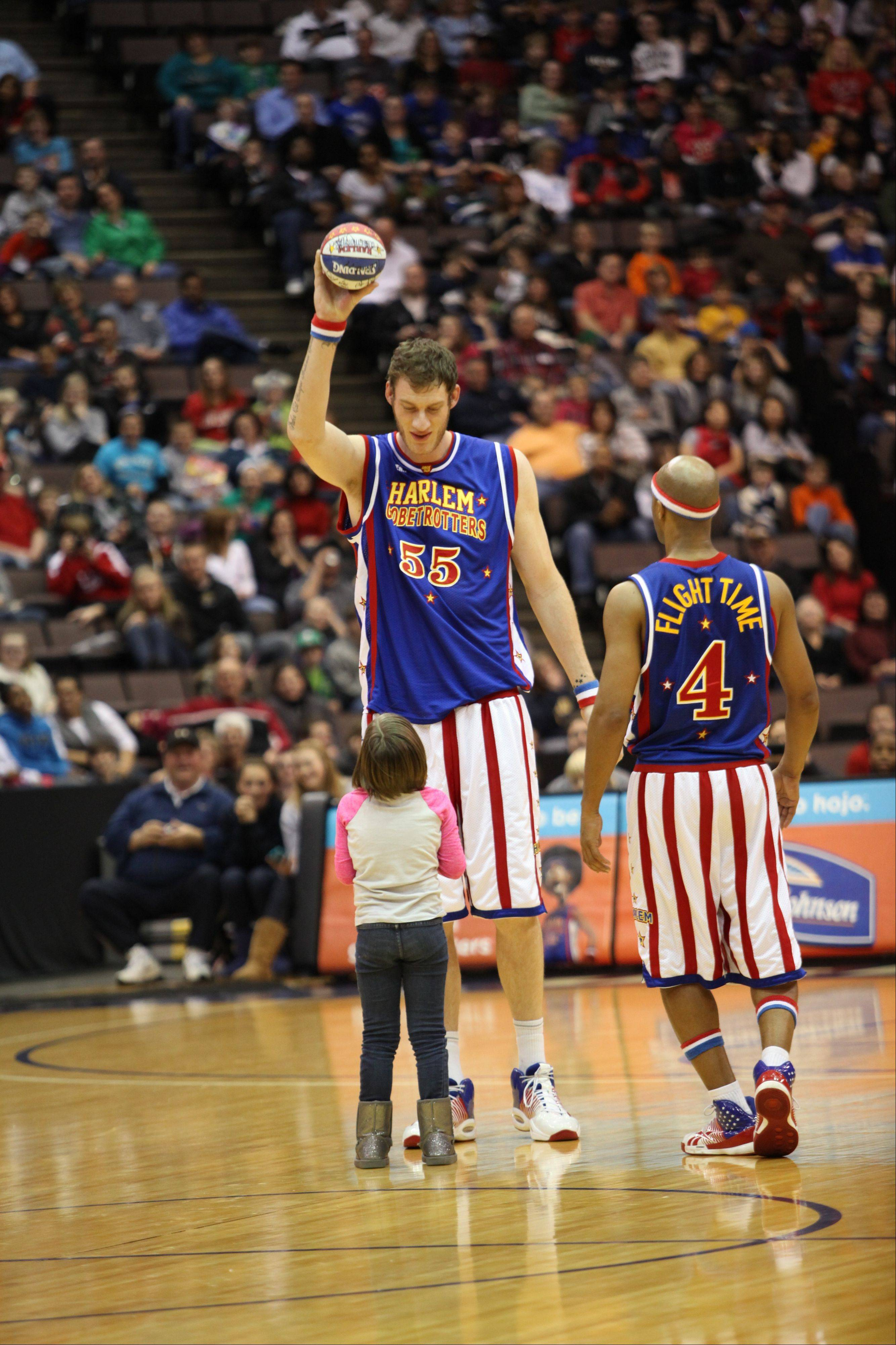 Tiny Sturgess and Flight Time Lang of the Harlem Globetrotters clown around with a basketball. The comedy basketball team comes to the Allstate Arena in Rosemont for two games on Friday, Dec. 28.