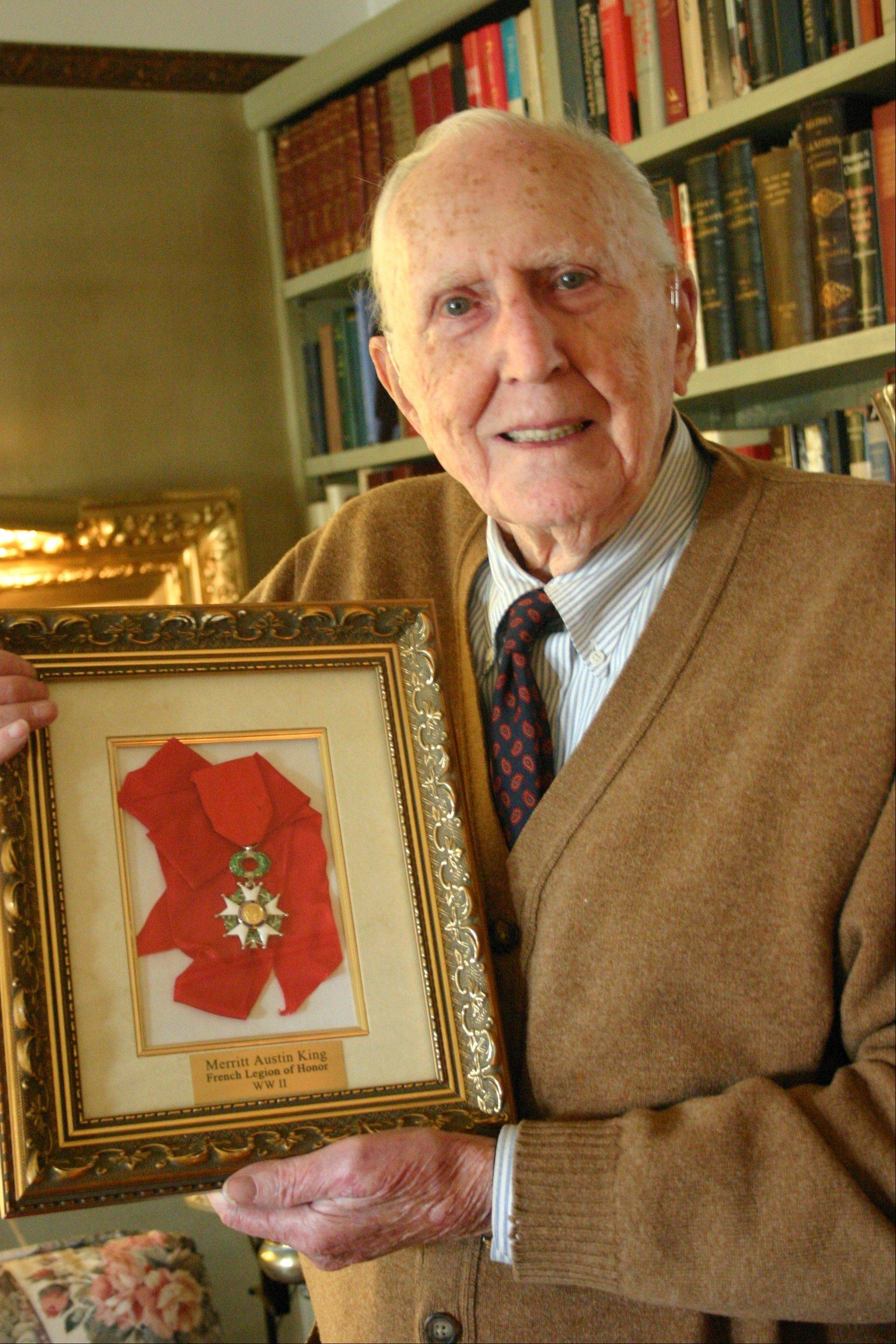 Merritt King of Geneva with the French Legion of Honor medal, which was bestowed on him in 2009. He landed with the Allies on Omaha Beach in the third day of the famous 1944 invasion.