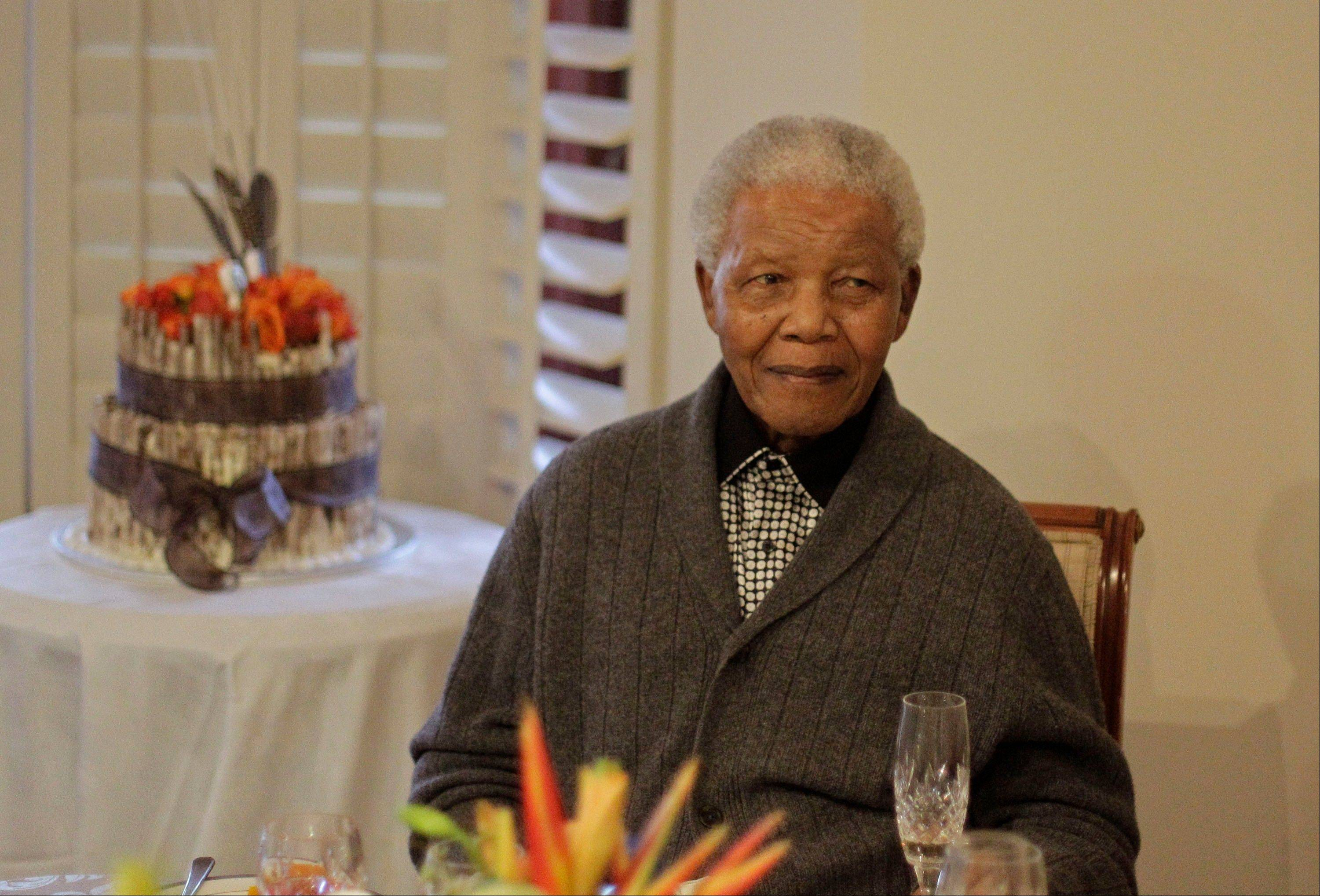 In this Wednesday, July 18, 2012 file photo, former South African President Nelson Mandela as he celebrates his birthday with family in Qunu, South Africa.