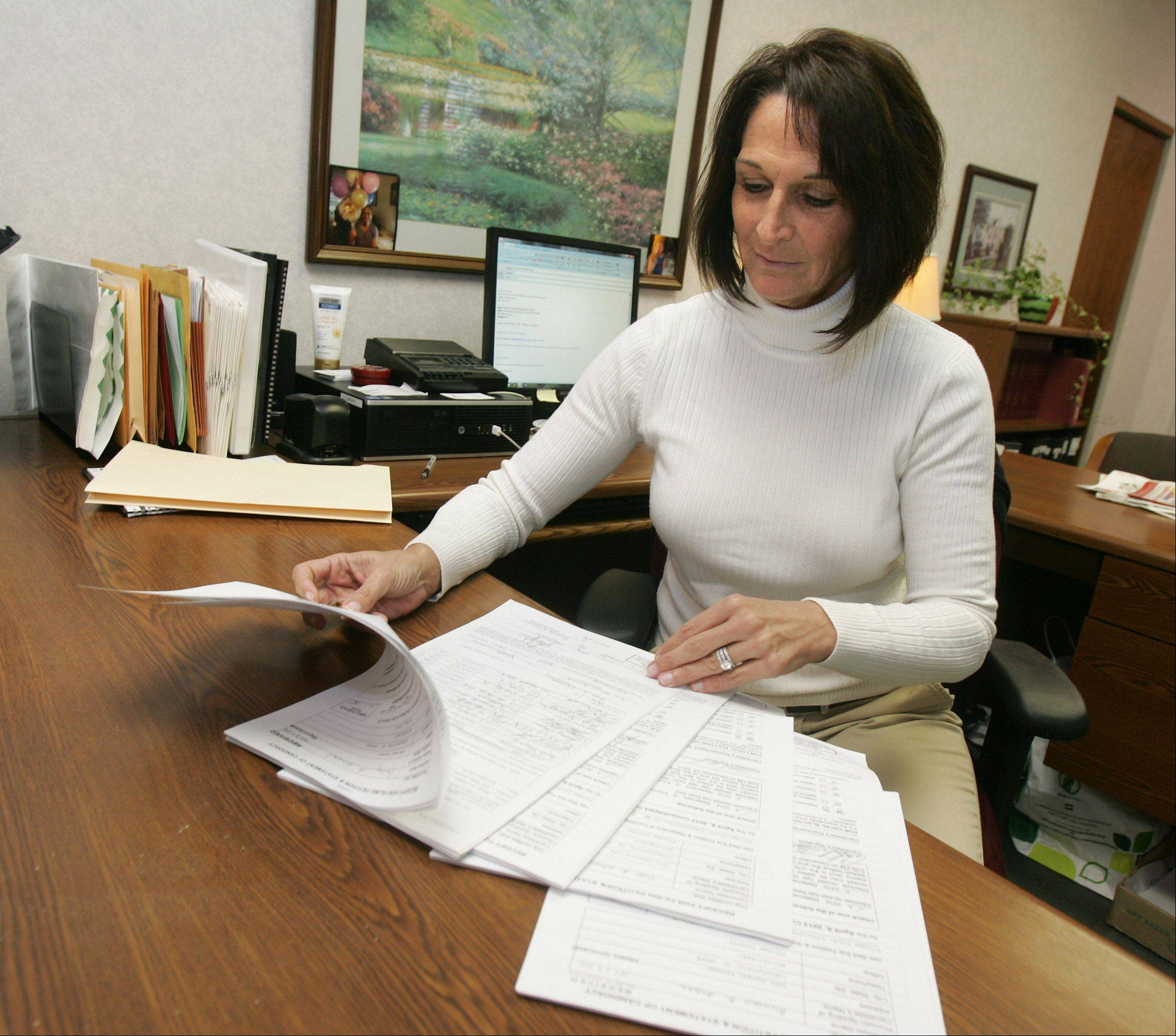 Executive Secretary Kelly Johnson looks through election petitions at Libertyville Village Hall Wednesday.