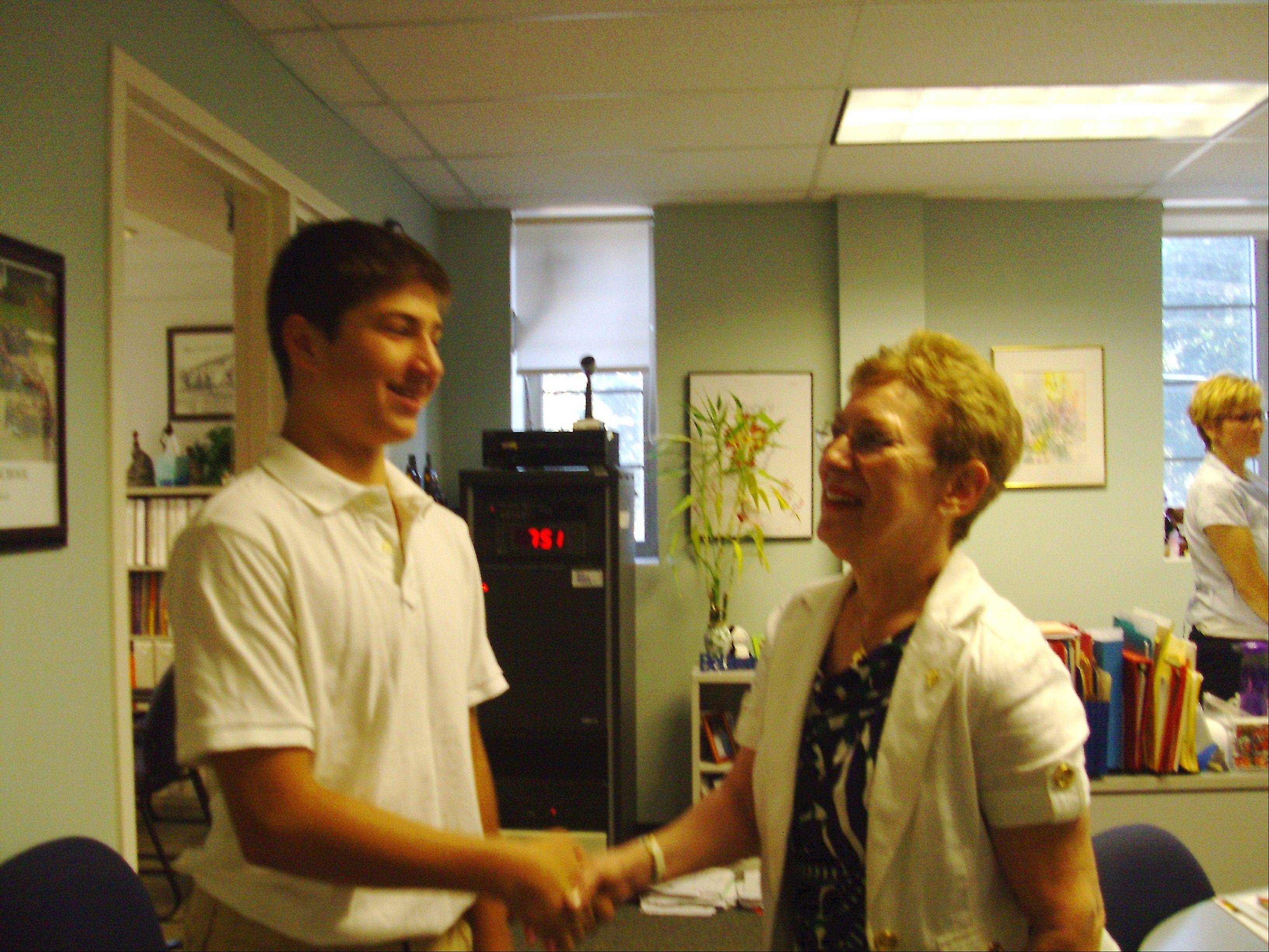 Principal Sr. Ann Busch in 2010 with then-eighth grader Sam Torrence of Barrington. ¬