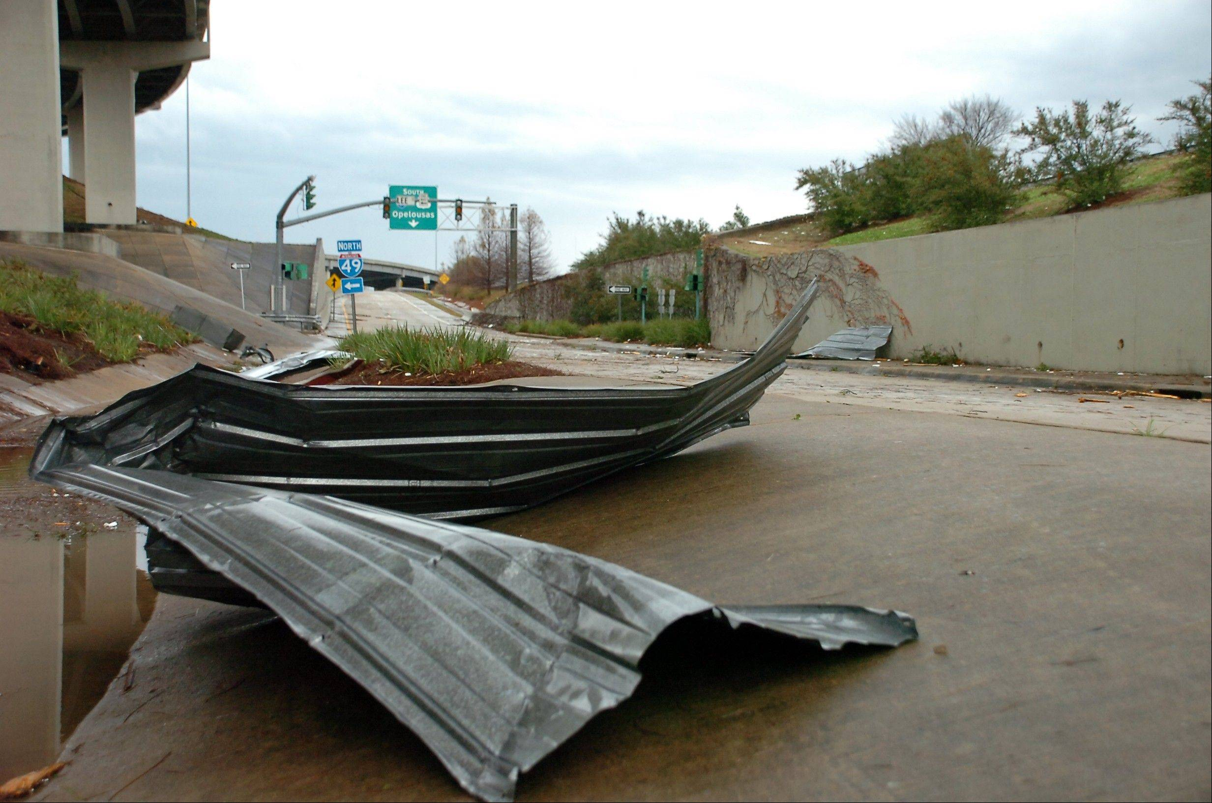Debris sits on the frontage road near I-49 in downtown Alexandria, La., after an apparent tornado tore through the area Tuesday, Dec. 25, 2012.