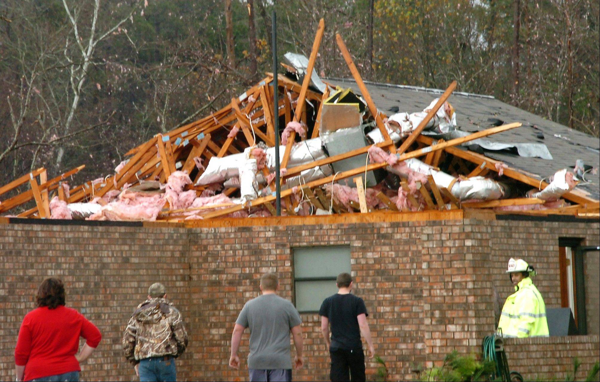 A house in Tioga, La., is severely damaged after an apparent tornado tore through the area Tuesday, Dec. 25, 2012.