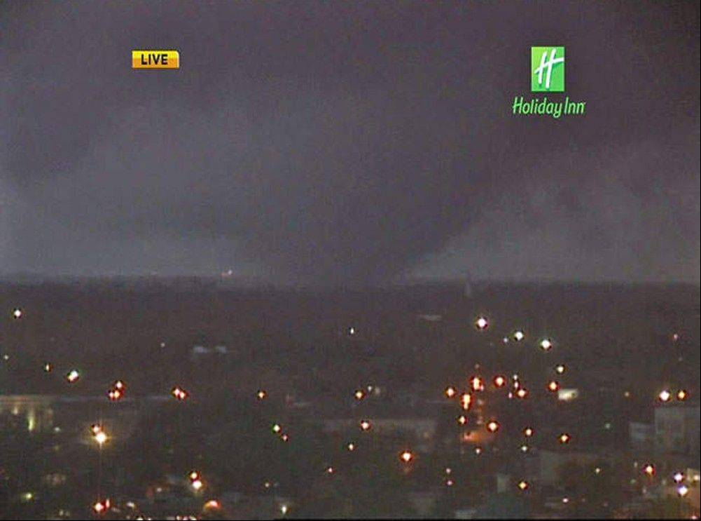 In this image from video provided by WALA-TV in Mobile, Ala. a tornado touches down in Mobile on Tuesday, Dec. 25, 2012. The tornado hit some areas of downtown Mobile Tuesday, causing severe damage in the area before moving north, officials said.