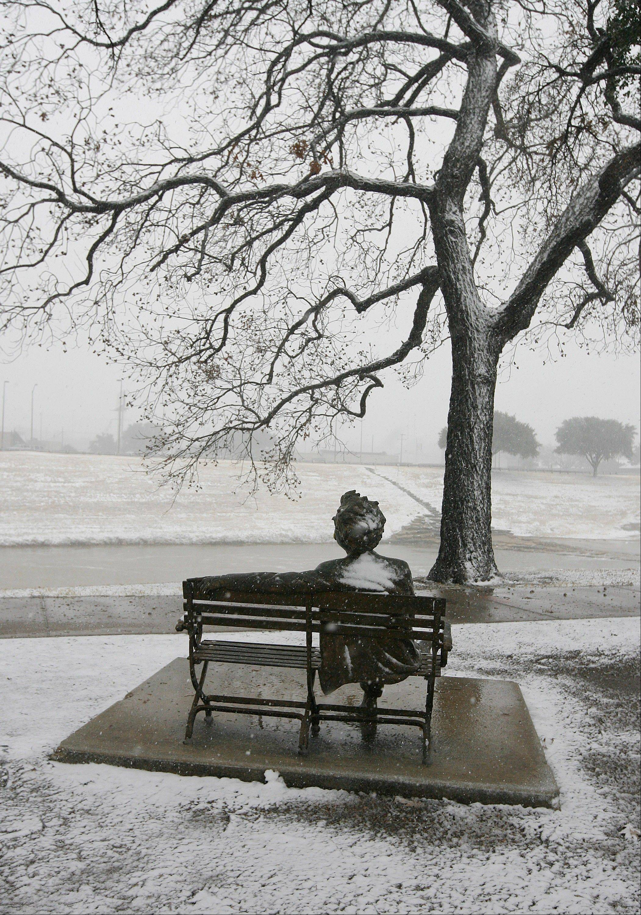 Snow falls on the Mark Twain statue on the banks of the Trinity River in Fort Worth, Texas on Christmas Day, Tuesday, Dec. 25, 2012.