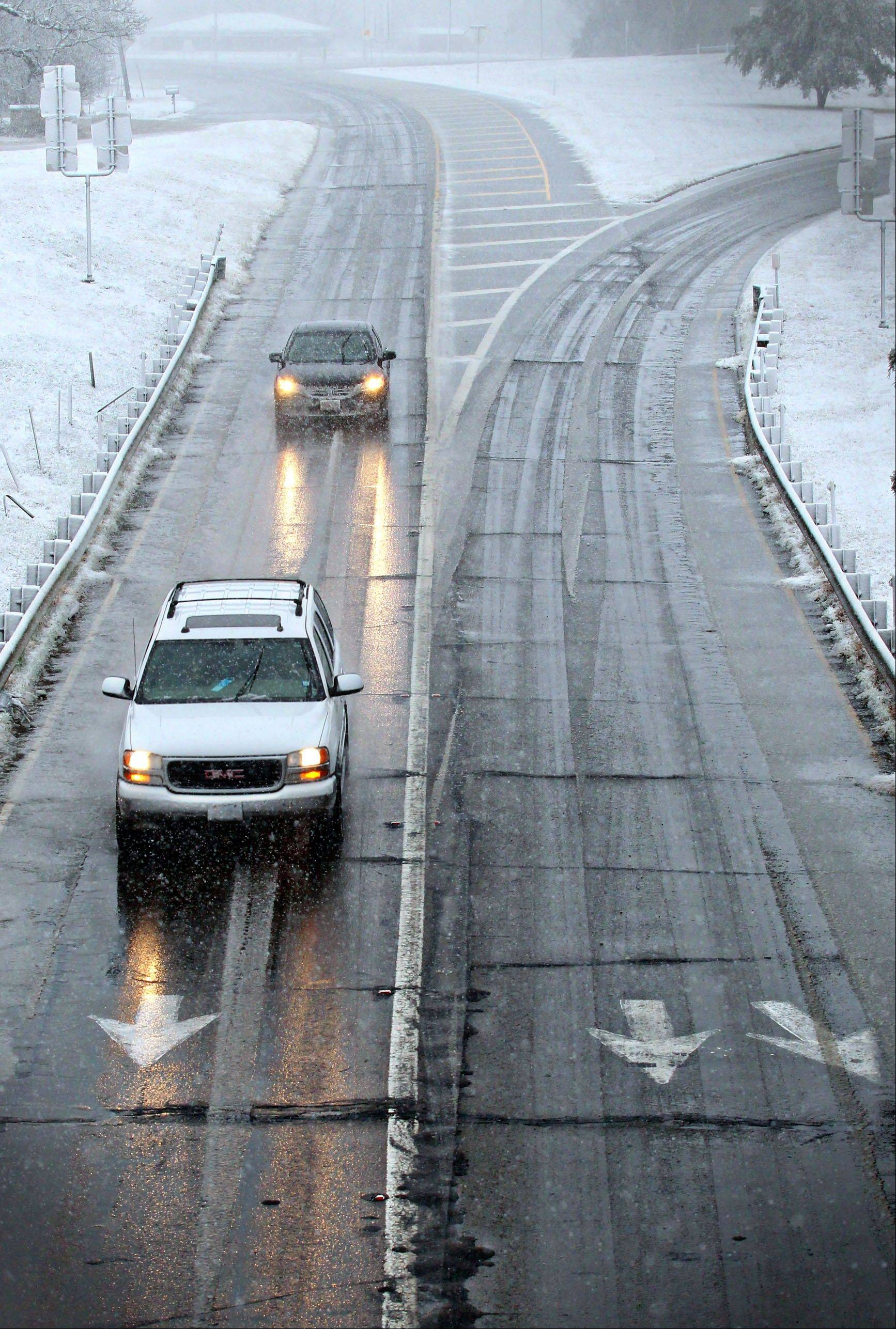 Drivers maneuver wet and icy roads in Paris, Texas Tuesday, Dec. 25, 2012 after a strong winter system dropped inches of rain and snow on most of North East Texas.