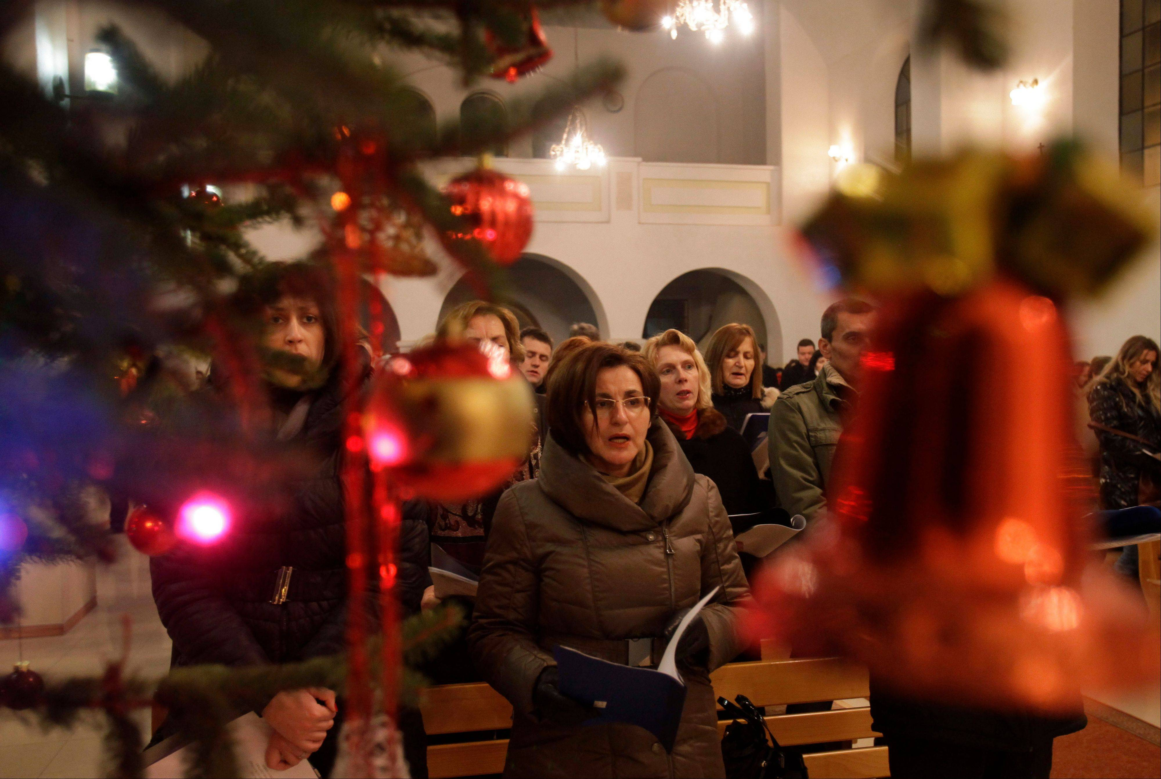 Bosnian Croats attend a Christmas Mass in a church in the village of Morancani, near Tuzla 70 kilometers (44 miles) north of Sarajevo, Bosnia, Tuesday, Dec. 25, 2012.