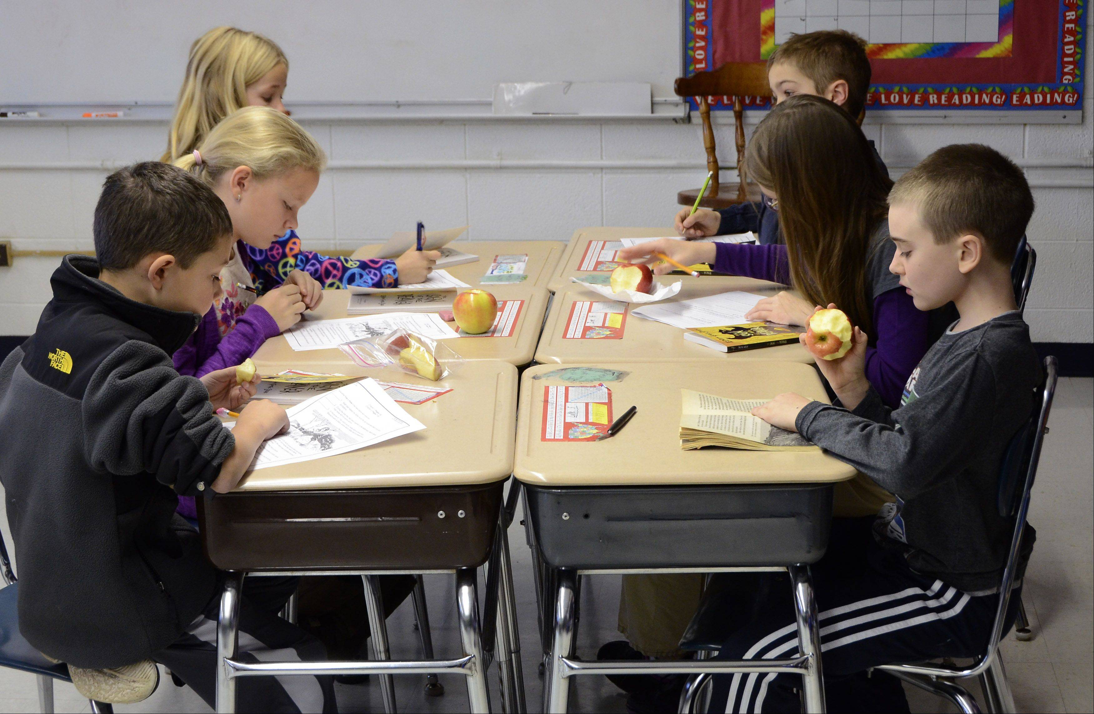 "Students at Windsor Elementary School in Arlington Heights District 25 eat a snack during a midmorning class. District 25 ""allows the consumption of healthy snacks at school"" but does not specify what's healthy."