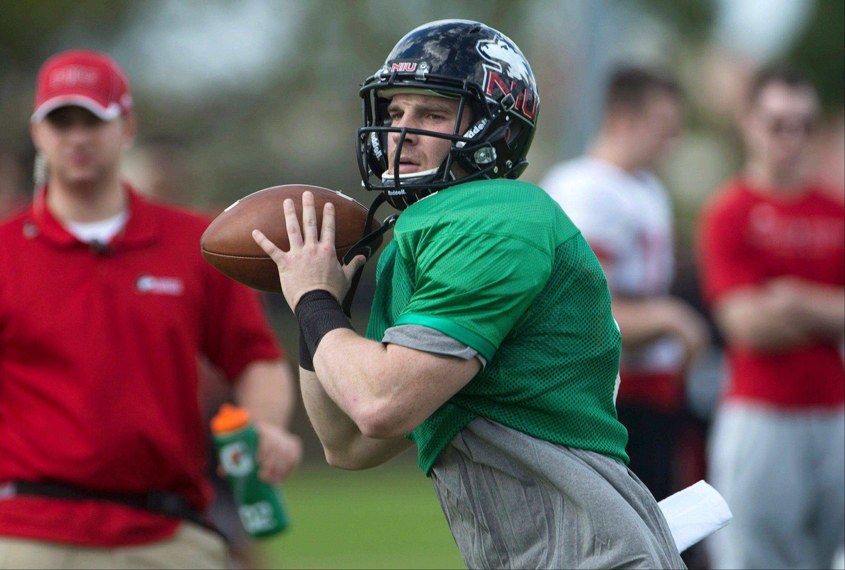 Northern Illinois quarterback Jordan Lynch throws a pass Wednesday during practice.