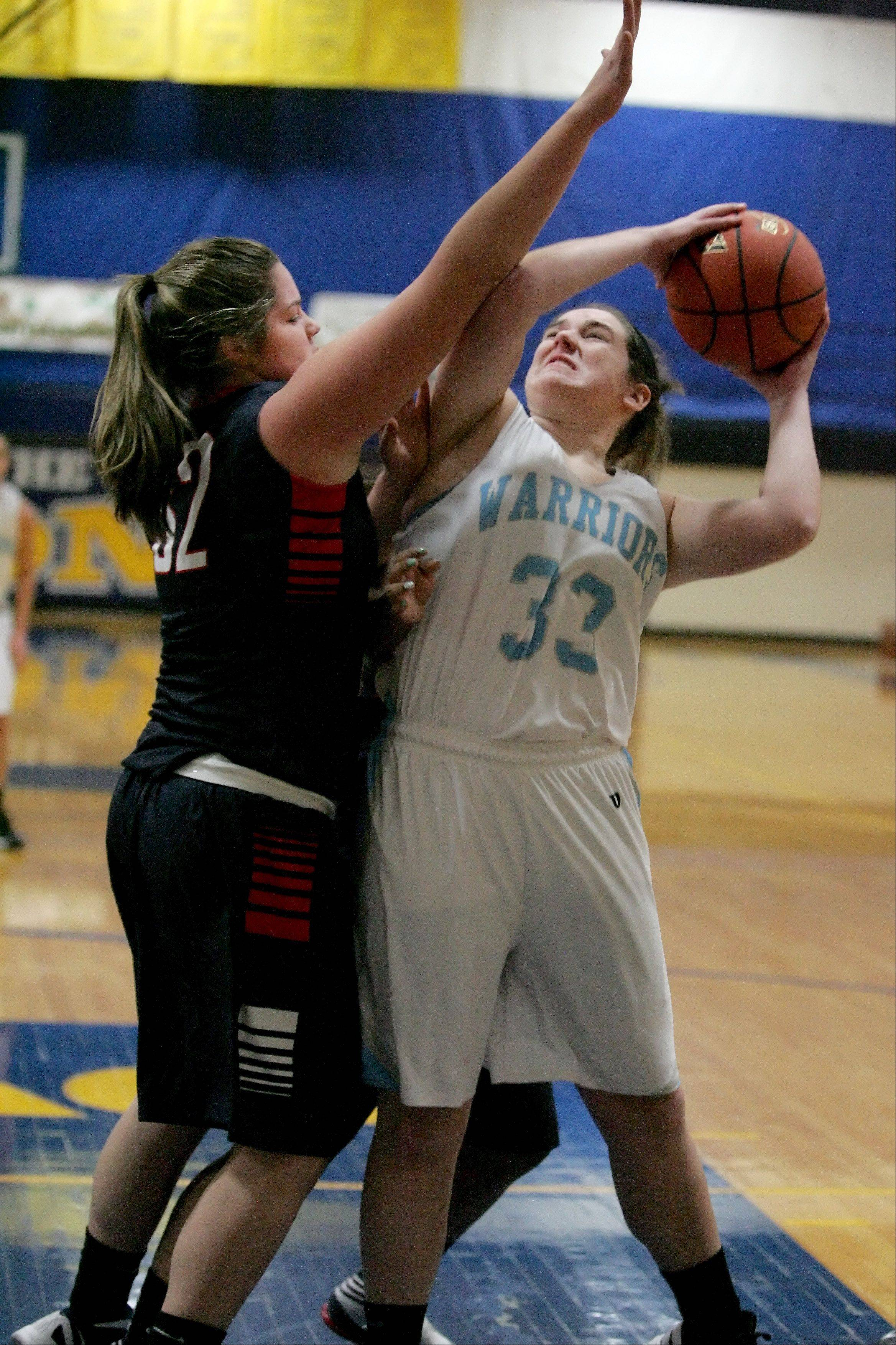 Anna Lentsch of Willowbrook, right, looks for room to shoot a basket as Molly Jordan, left, of West Aurora defends in girls basketball action at the 2012 Bill Neibch Holiday Tournament at Wheaton North High School on Wednesday.