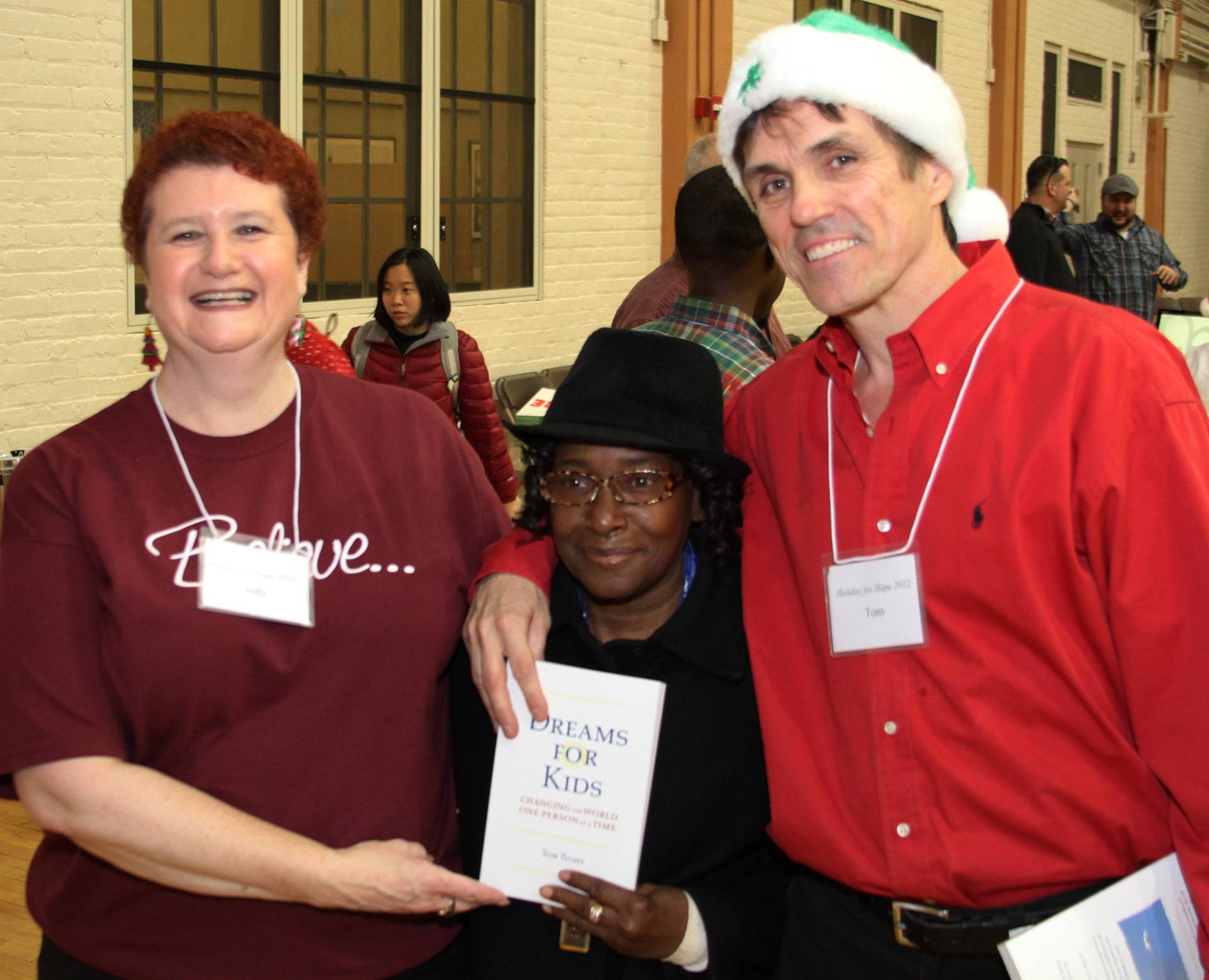 Chiro One Community Outreach Director, Cynthia Barron (left) and Dreams For Kids Founder, Tom Tuohy (right) with Clara Kirk of Clara's House Shelter, where the very first Holiday for Hope took place 24 years ago.