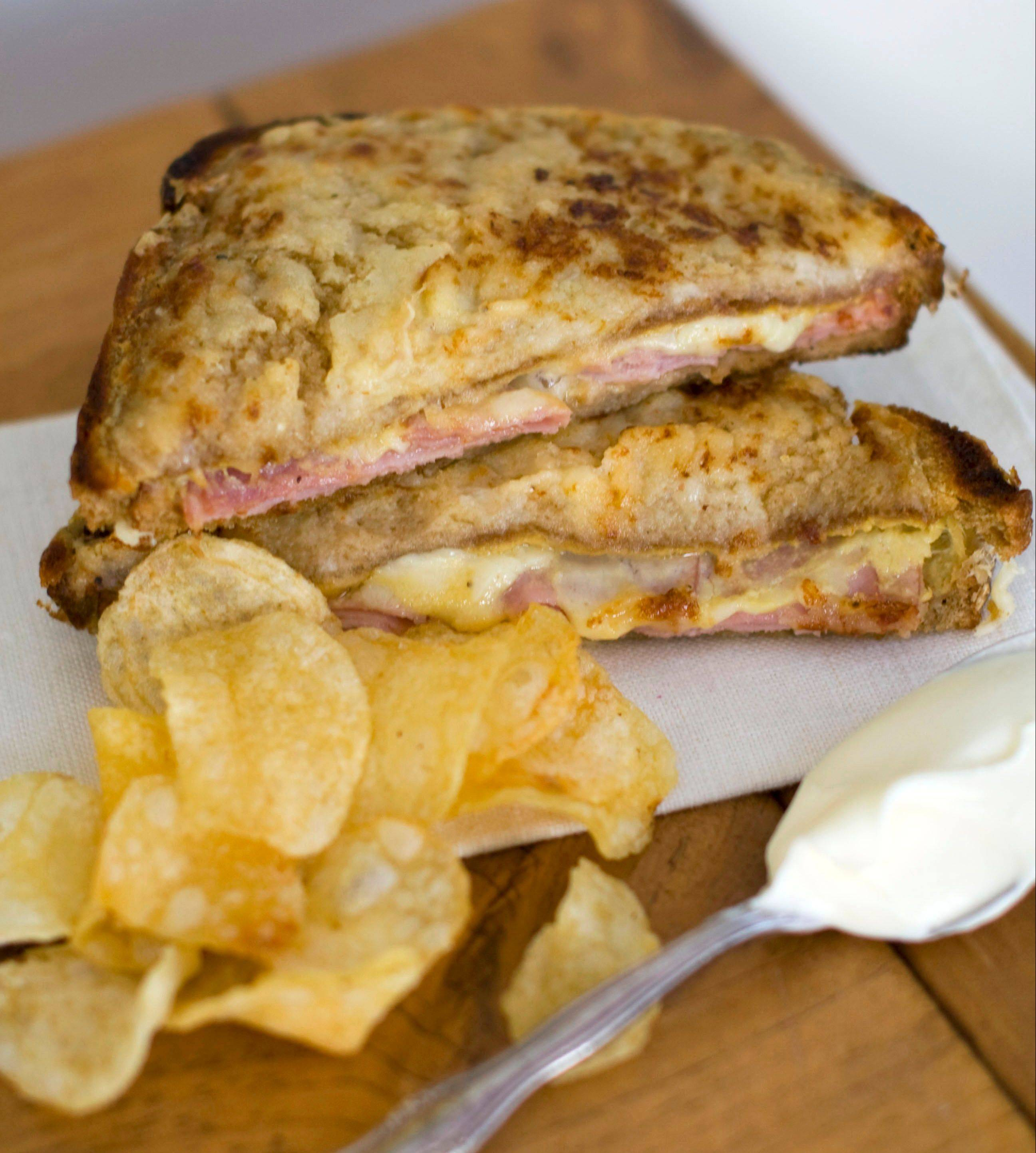 Creme fraiche thickened with cornstarch and pepper sauce adds to the oo-la-la factor of Croque Monsieur sandwiches.