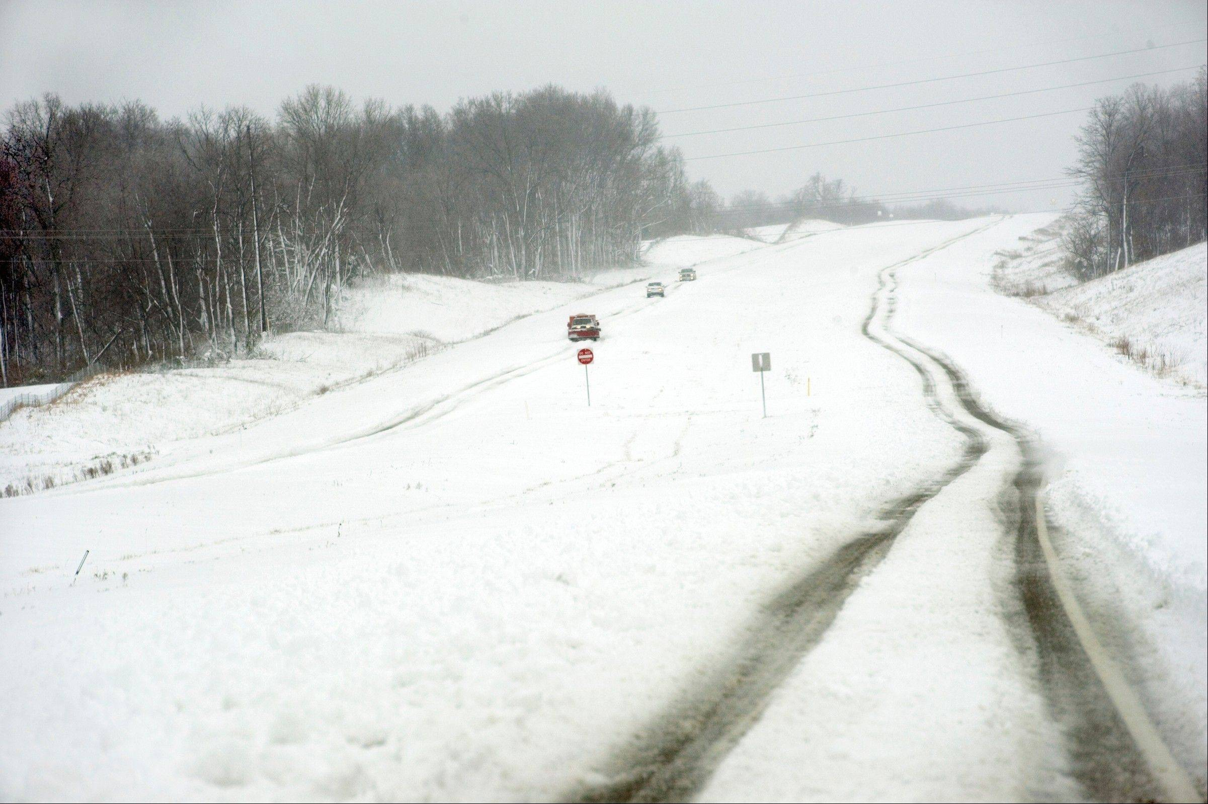 Associated Press Travel on University Parkway west of Evansville, Ind. on Wednesday morning.