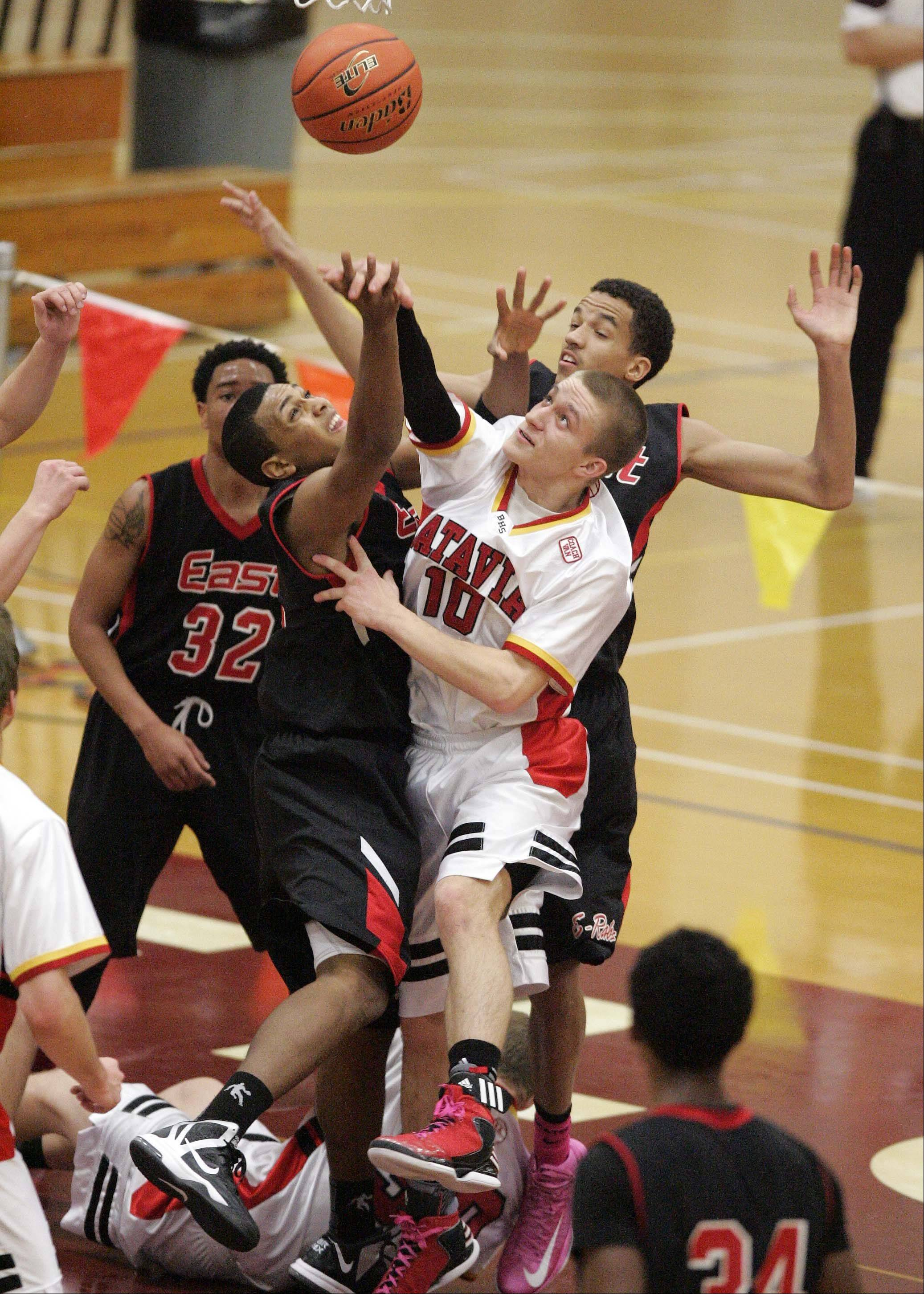 Batavia guard Mike Rueffer (10) knocks a rebound away from Rockford East at the 38th Annual Elgin Boys Holiday Basketball Tournament Thursday December 27, 2012.