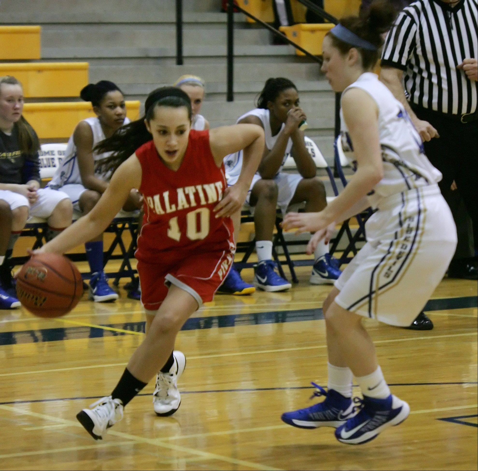 Palatine guard Samantha Heuertz drives to the basket past Warren guard Rachel Brown during the Palatine at Warren girls high school basketball game in the Blue Devil Classic Thursday at Warren High School in Gurnee.