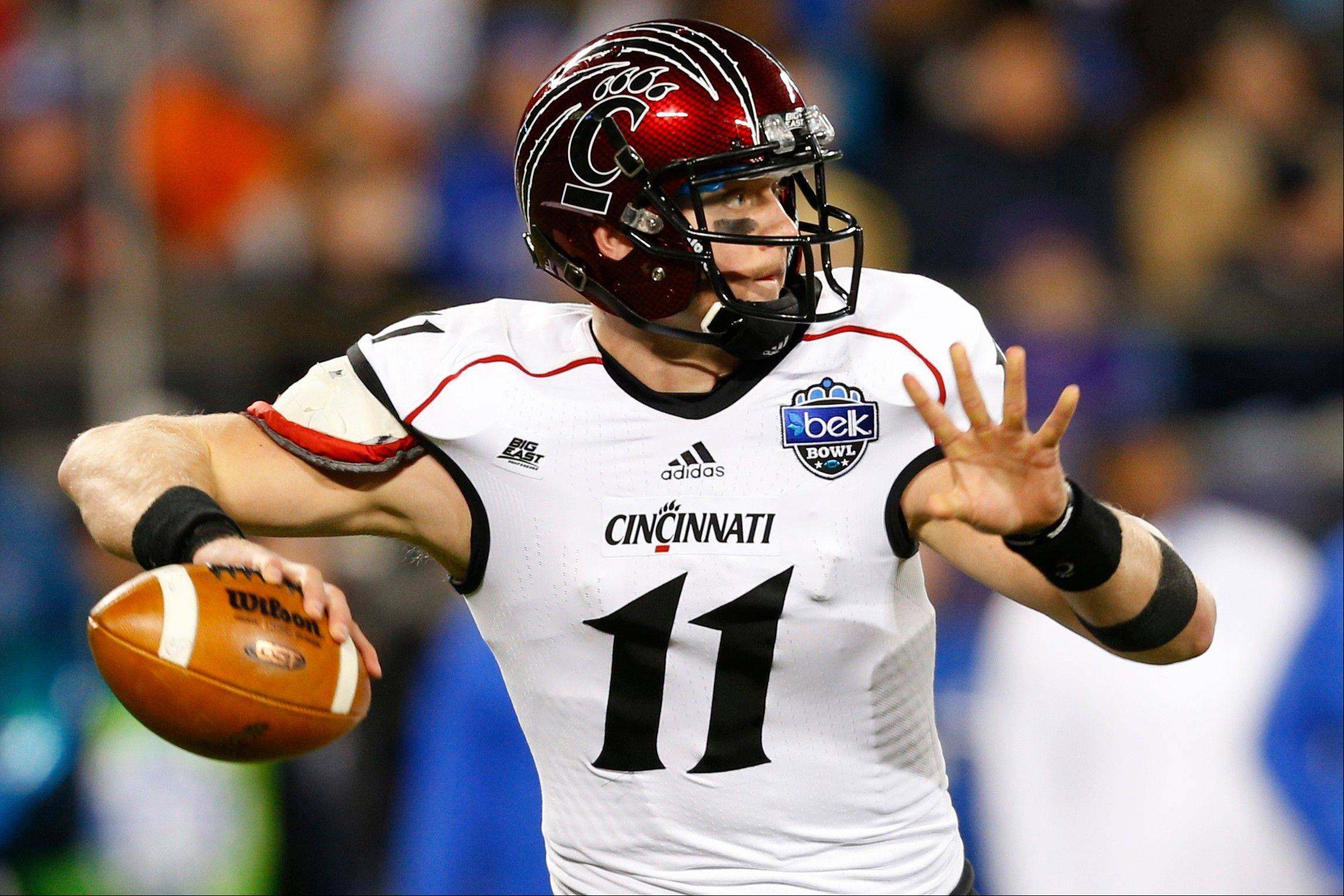 Brendon Kay threw for 332 yards and a Belk Bowl-record four touchdowns, and Cincinnati capitalized on Duke's inept play in the closing minutes to beat the Blue Devils 48-34 on Thursday night.