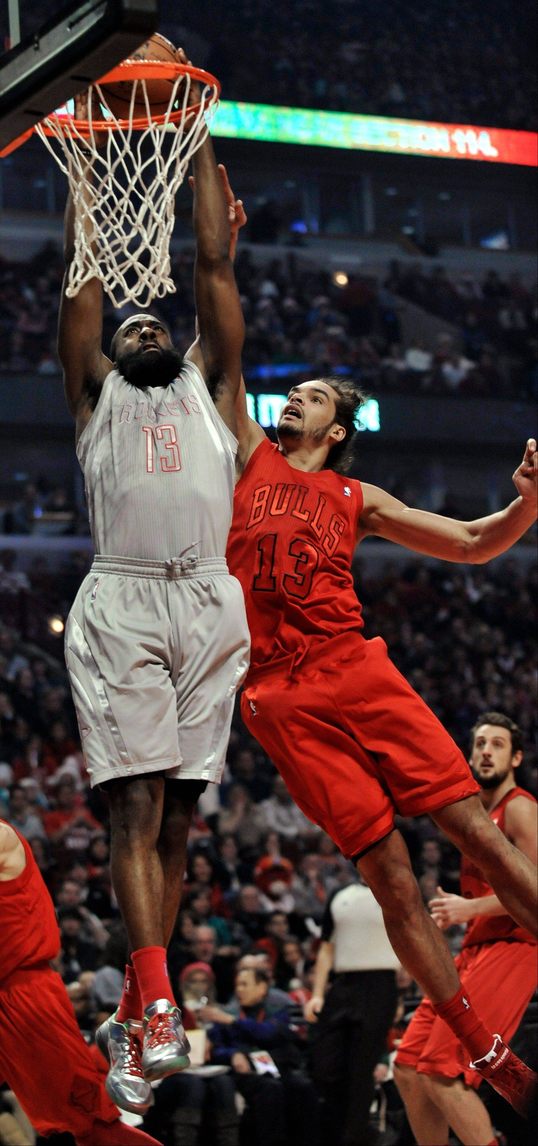 The Rockets� James Harden dunks over center Joakim Noah during the Bulls� 120-97 loss Tuesday night at the United Center.