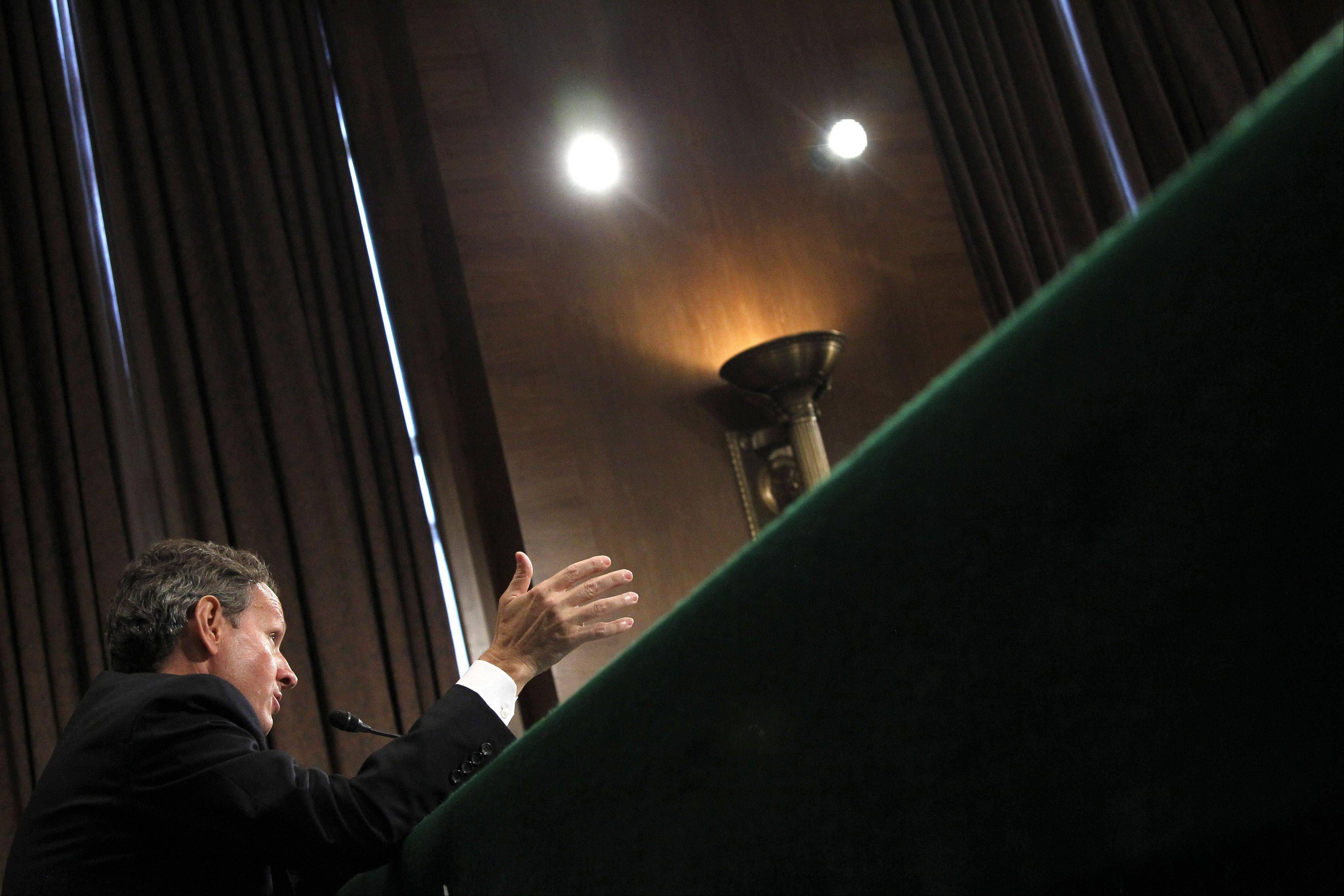 Treasury Secretary Timothy Geithner testifies on Capitol Hill in Washington, before the Senate Banking Committee hearing.