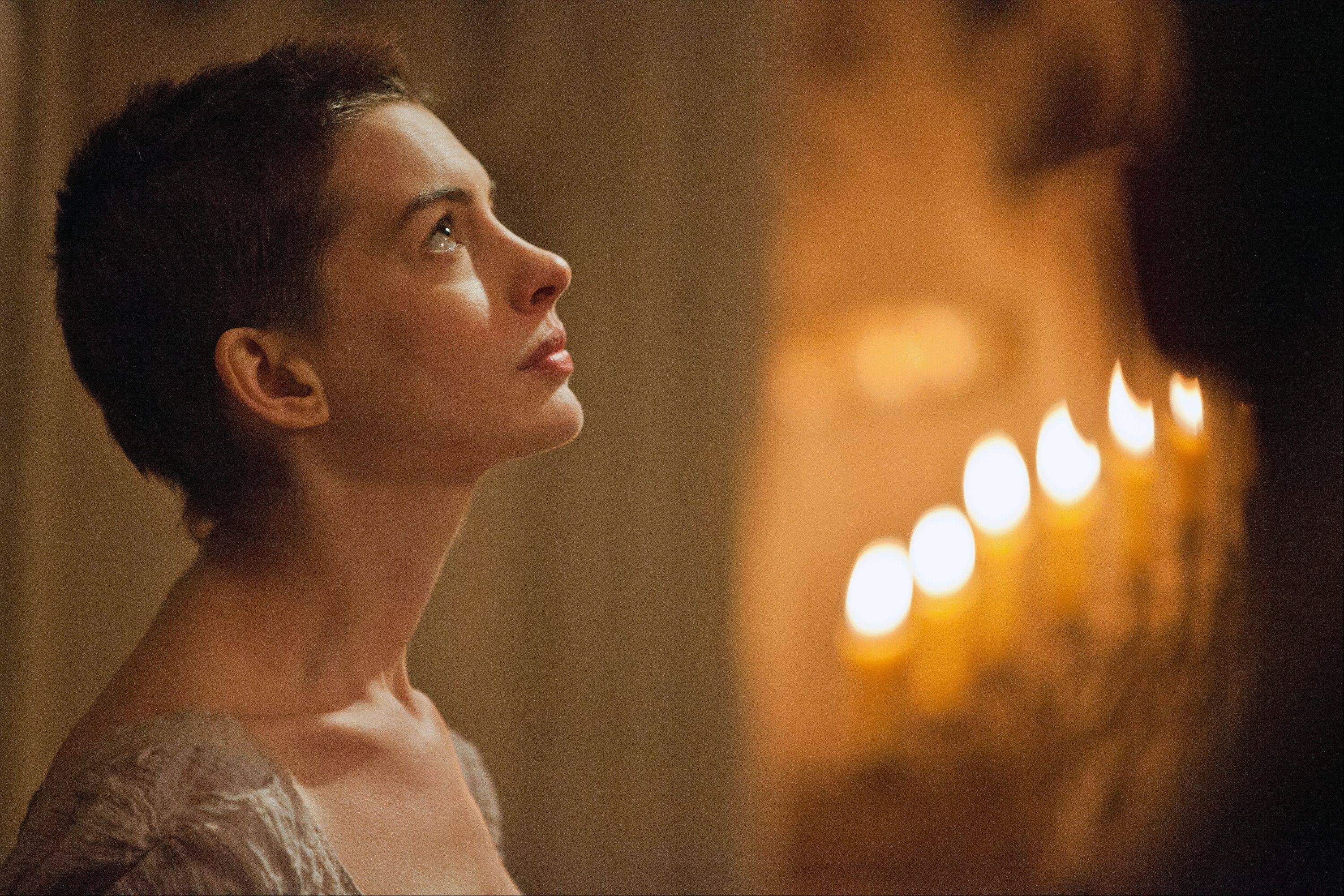 "This film image released by Universal Pictures shows actress Anne Hathaway portraying Fantine, a struggling, sickly mother forced into prostitution in 1800s Paris, in a scene from the screen adaptation of ""Les Miserables."""