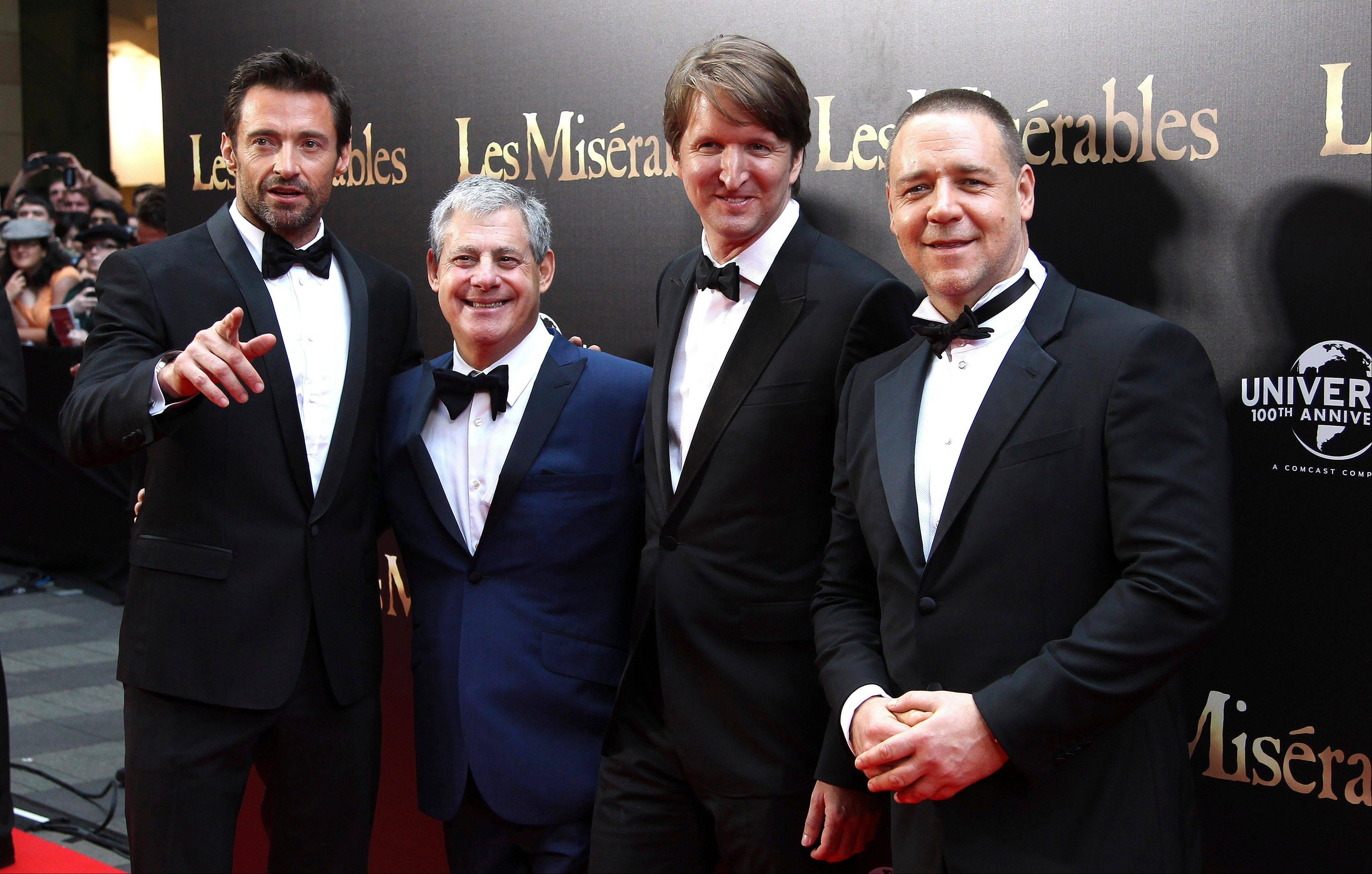 "Hugh Jackman, from left, Sir Cameron Mackintosh, director Tom Hooper and Russell Crowe walk down the red carpet at the premier of ""Les Miserables"" in Sydney, Australia, Friday."