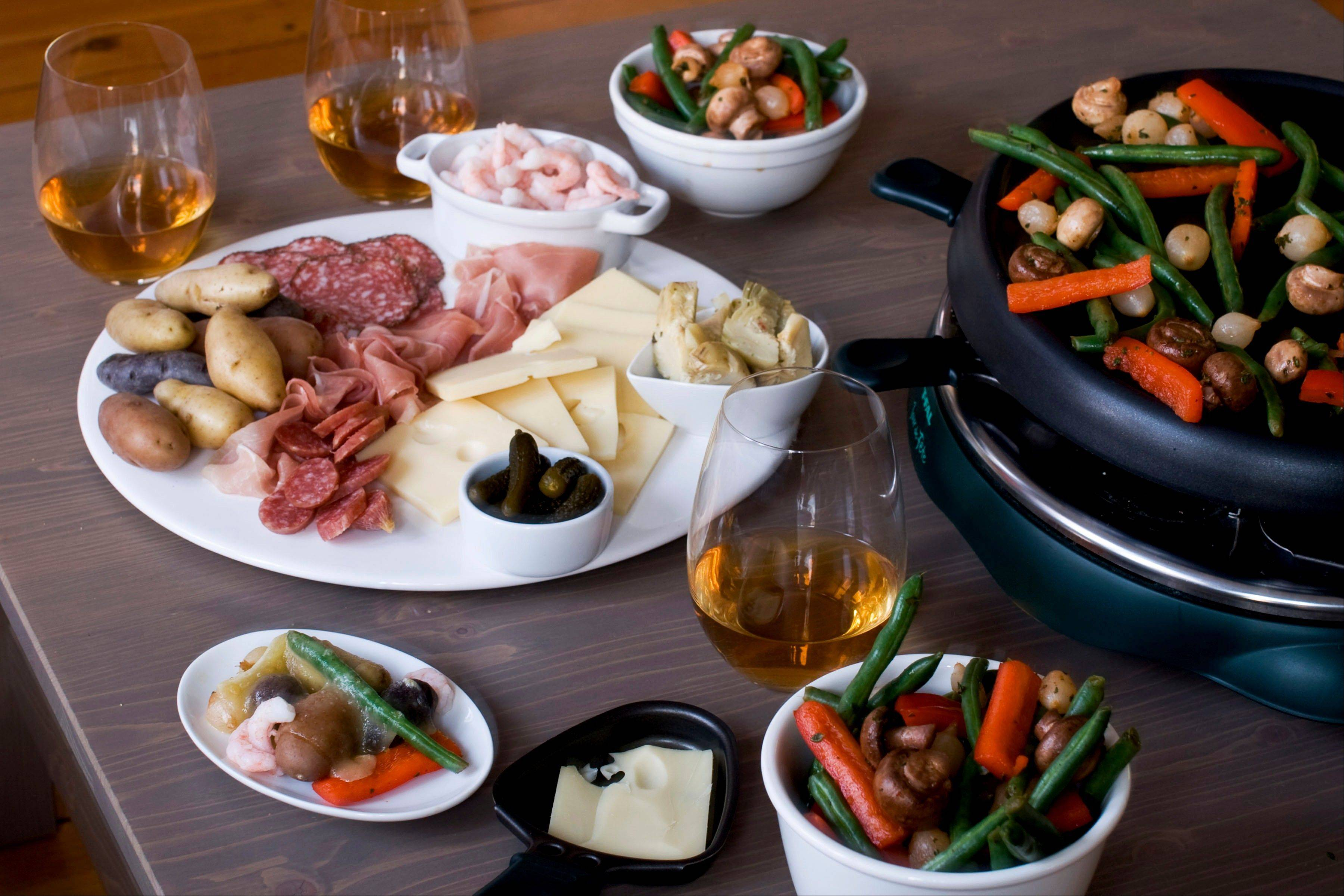 New Year's Eve is the perfect time to gather friends for raclette, a cheesy Alpine tradition that's akin to fondue.