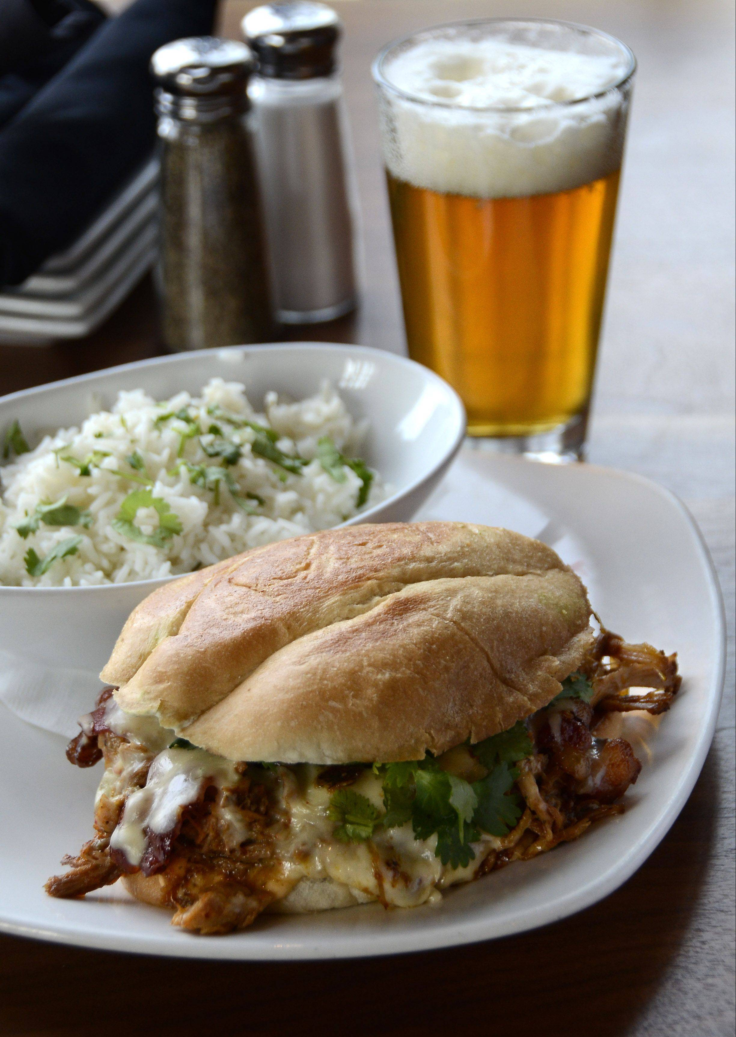 The Mexibano sandwich features spicy pulled pork with bacon and Chihuahua cheese and is one of the many well-crafted dishes available at Park Tavern in Rosemont.