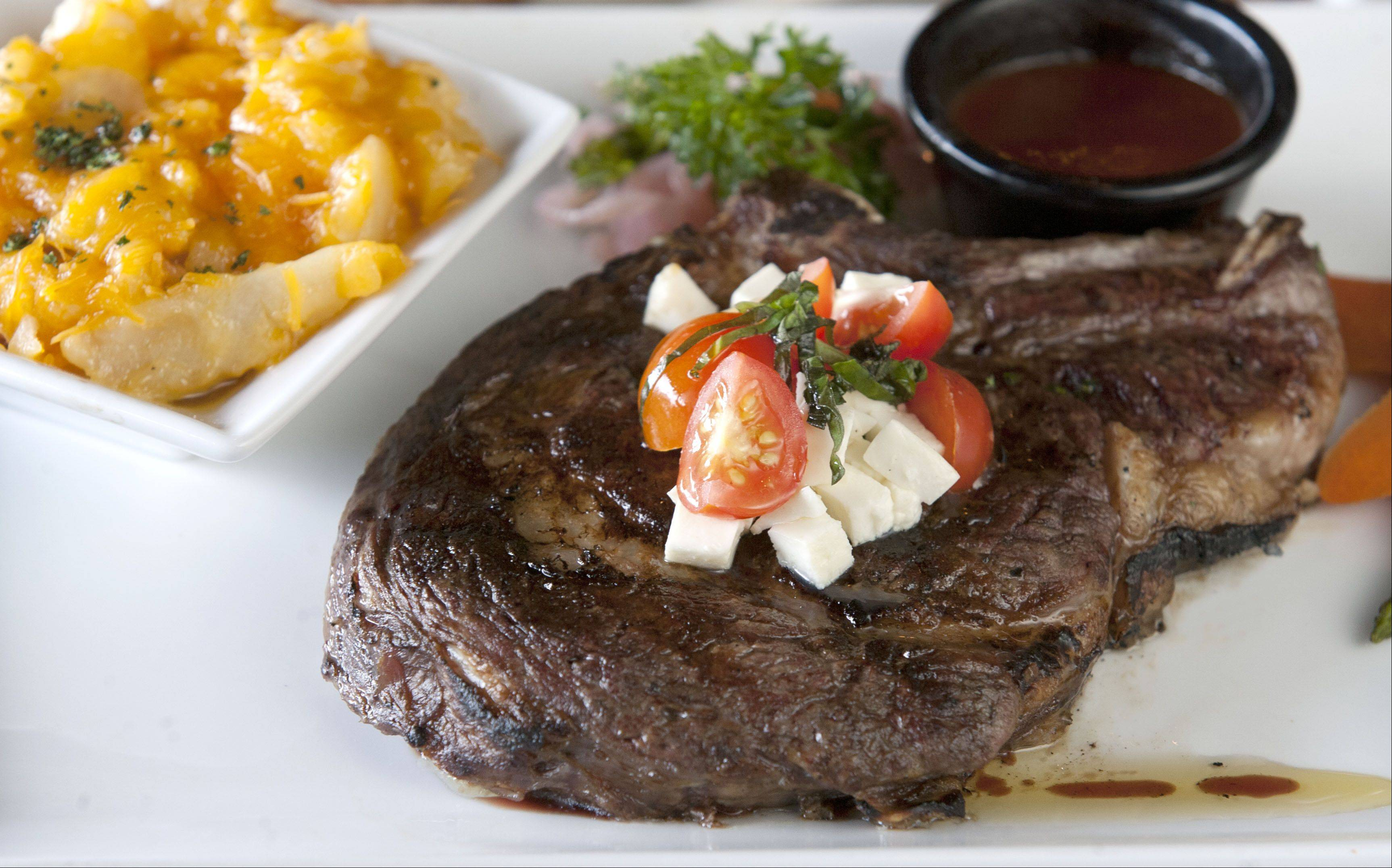 The Bank Restaurant in downtown Wheaton offers modern American cuisine and hearty portions, like this 20-ounce bone-in rib-eye steak.