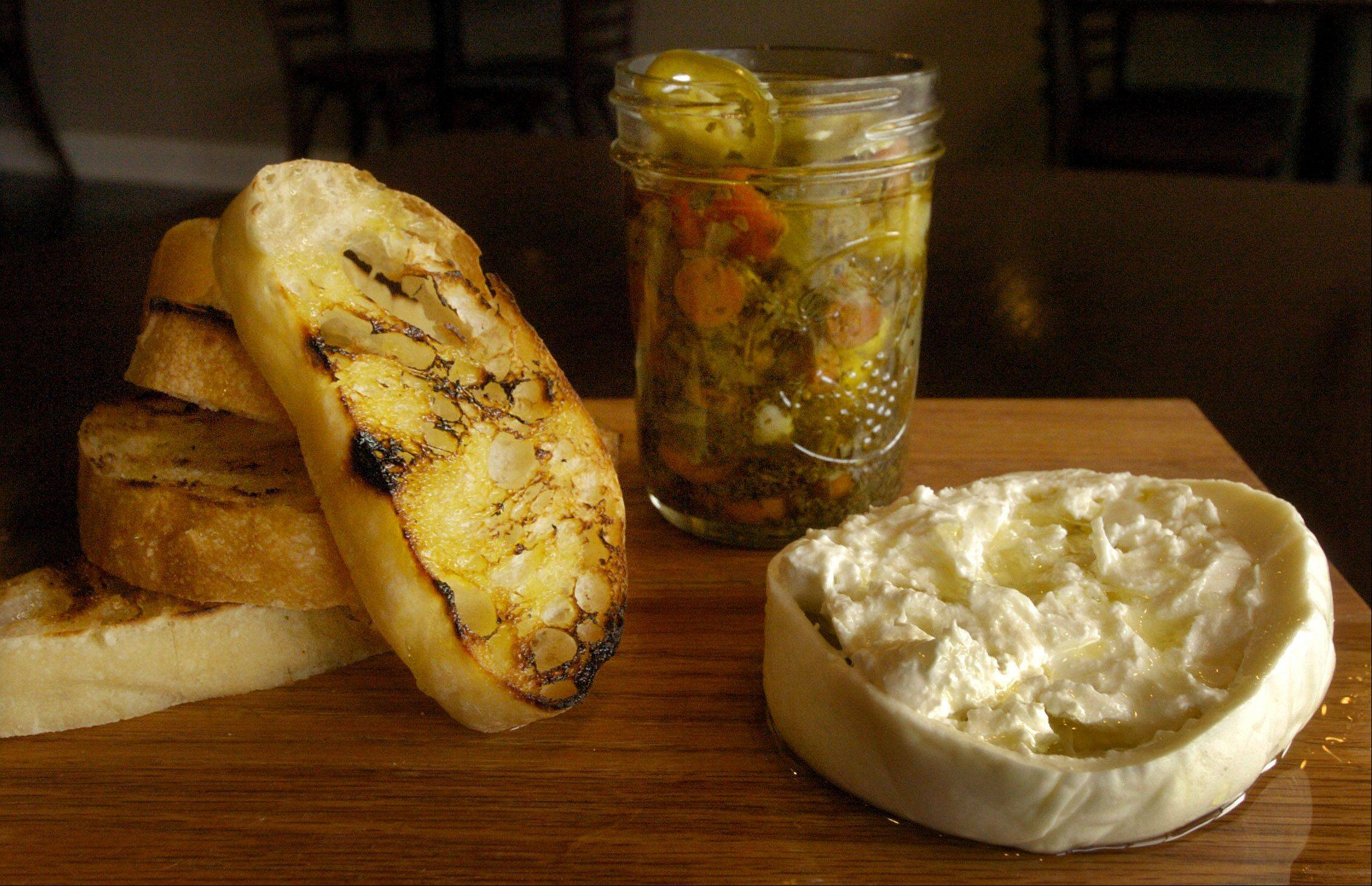 Italian-inspired small plates, like this burratta cheese with giardiniera, jalapeños and ciabatta, please diners at Near Restaurant in Barrington.