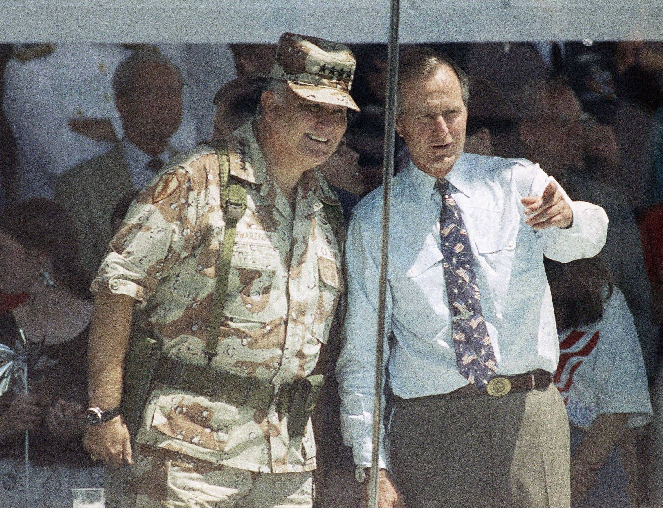 In this June 8, 1991, file photo, Gen. Norman Schwarzkopf and President George H.W. Bush watch the National Victory Parade from a viewing stand in Washington. Schwarzkopf led his troops in the parade, and then joined Bush in the reviewing stand. Schwarzkopf died Thursday, Dec. 27, 2012 in Tampa, Fla. He was 78.