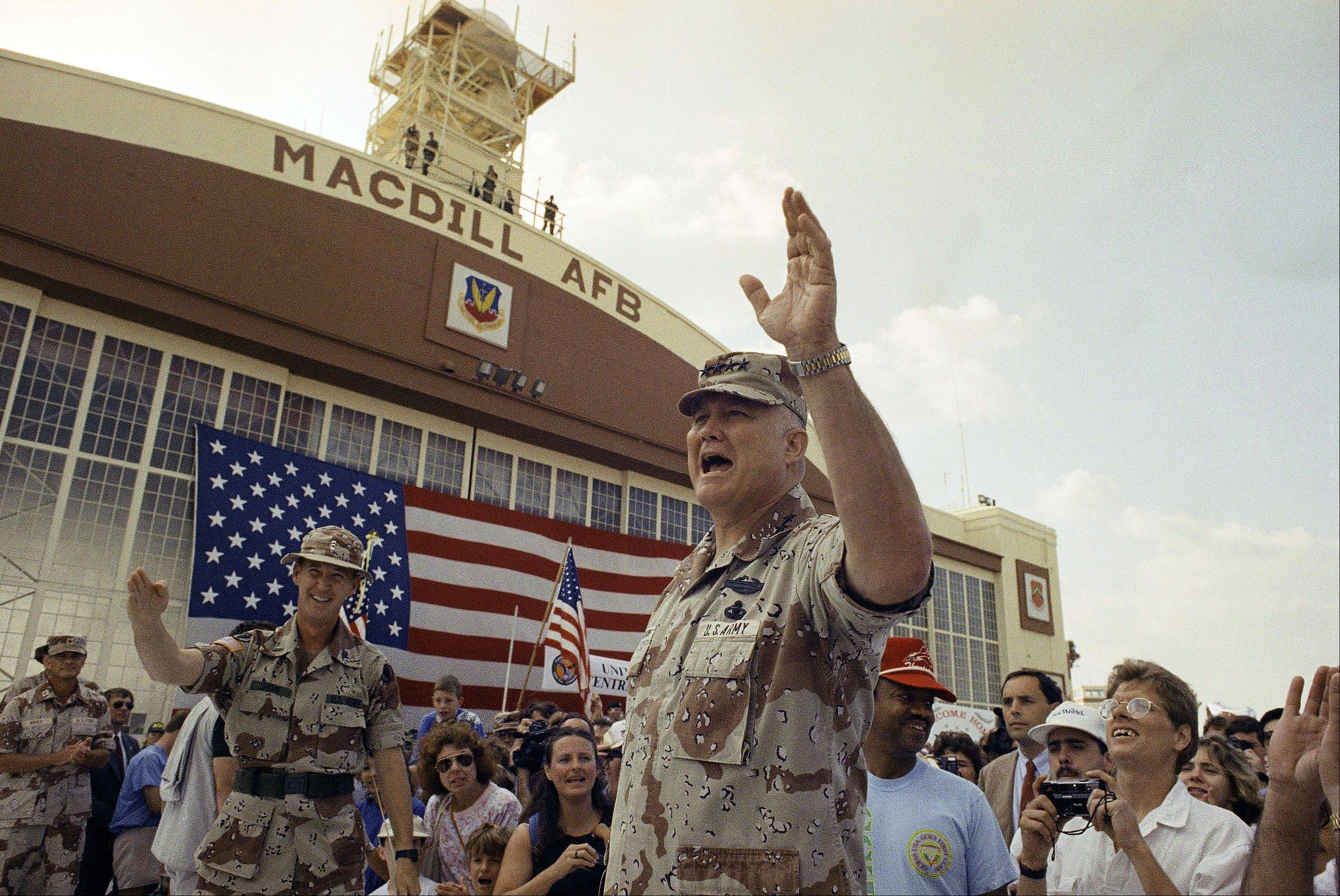 In this April 22, 1991, file photo, General H. Norman Schwarzkopf waves to the crowd after a military band played a song in his honor at welcome home ceremonies at MacDill Air Force Base in Tampa, Fla. Schwarzkopf died Thursday, Dec. 27, 2012 in Tampa, Fla. He was 78.