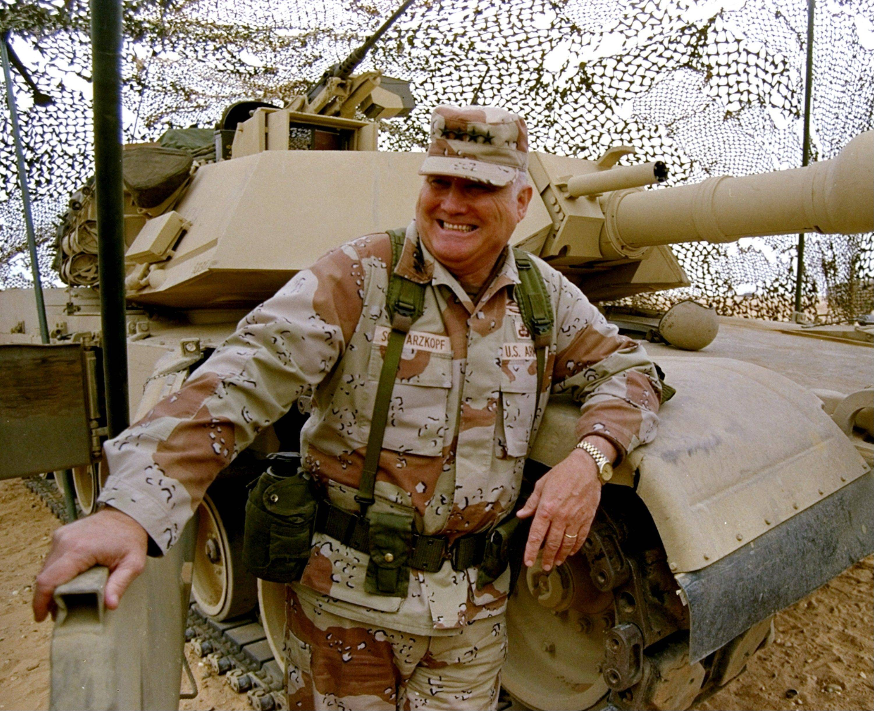 In this Jan. 12, 1991 file photo, Gen. H. Norman Schwarzkopf stands at ease with his tank troops during Operation Desert Storm in Saudi Arabia. Schwarzkopf died Thursday, Dec. 27, 2012 in Tampa, Fla. He was 78.