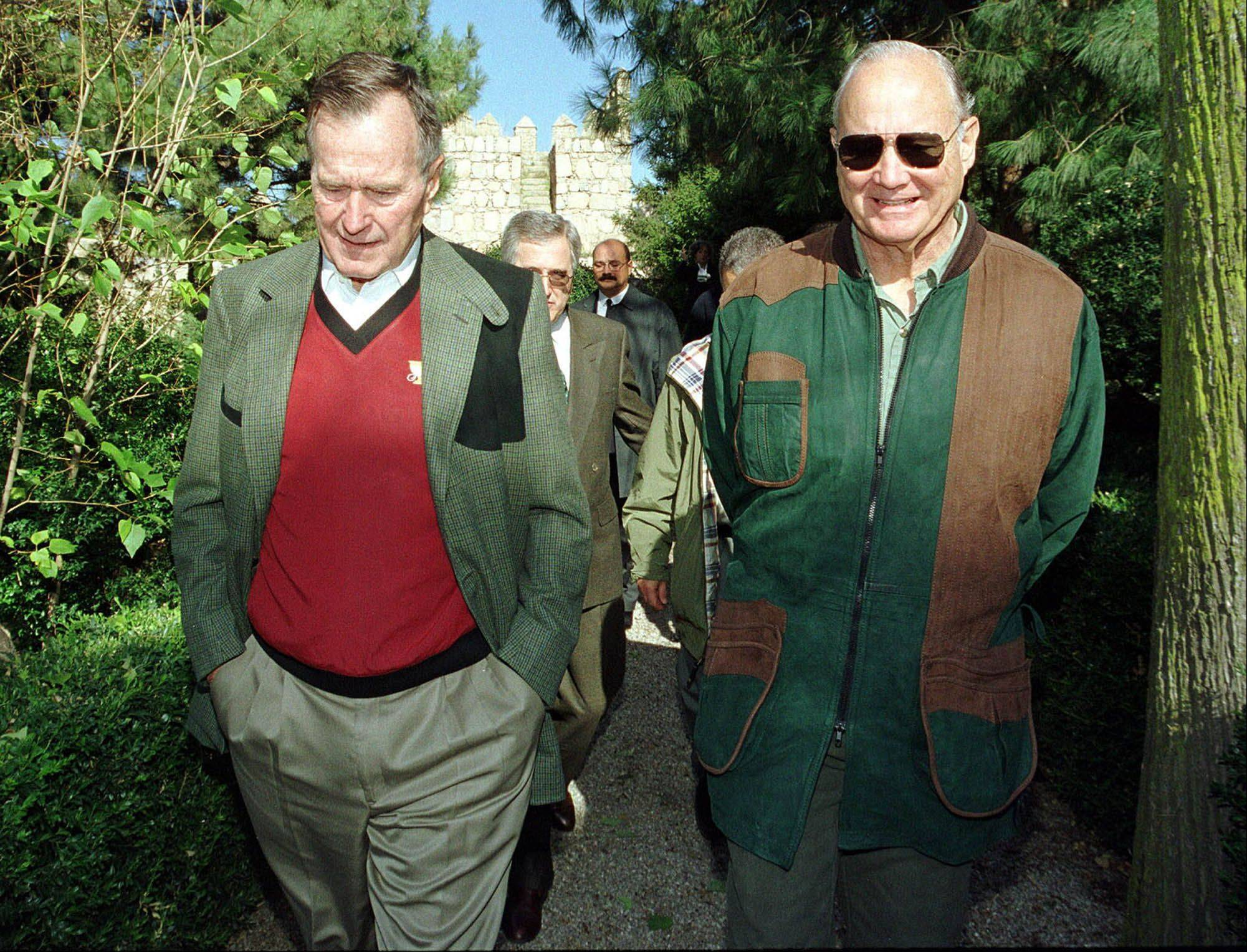 In this Nov. 11, 2000, file photo, former President George H.W. Bush, left, walks with retired Gen. Norman Schwarzkopf, right, in Avila, central Spain. Schwarzkopf died Thursday, Dec. 27, 2012 in Tampa, Fla. He was 78.