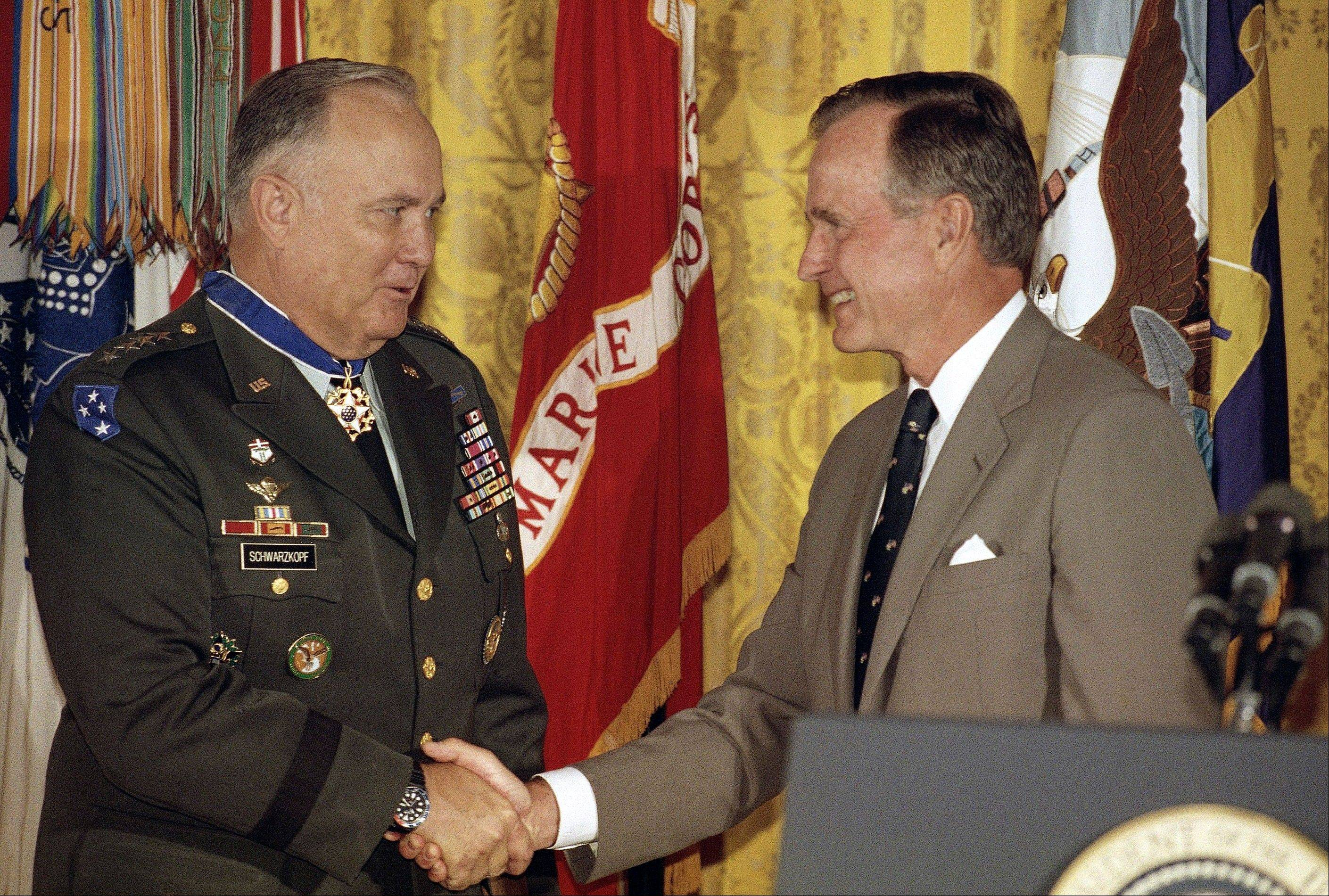 In this July 4, 1991, file photo, President George H.W. Bush congratulates Desert Storm commander Gen. Norman Schwarzkopf after presenting him with the medal of freedom at the White House in Washington. Schwarzkopf died Thursday, Dec. 27, 2012 in Tampa, Fla. He was 78.