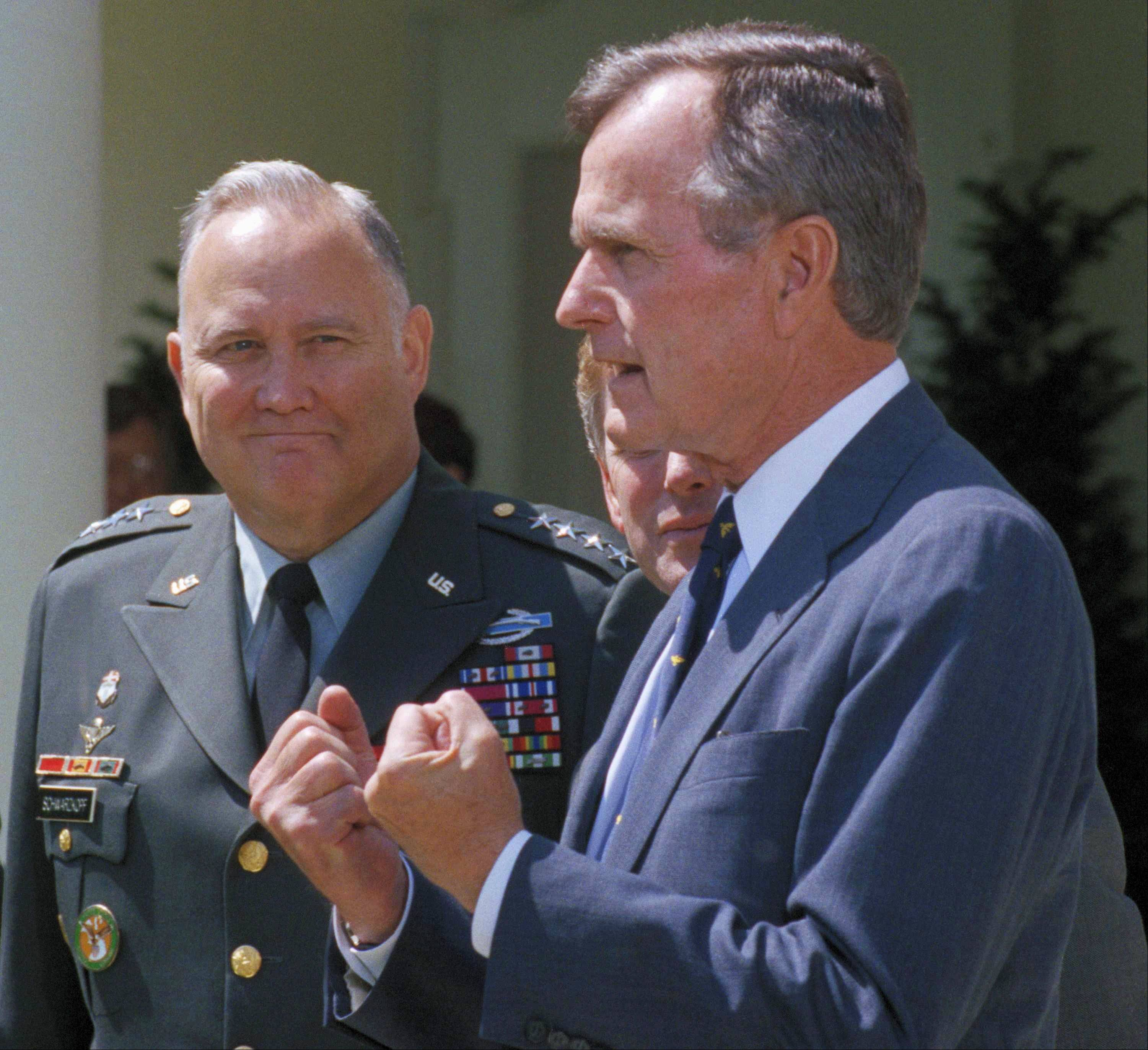"In this April 23, 1991, file photo, Gen. Norman Schwarzkopf, left, looks on as President George H.W. Bush speaks to reporters in the White House Rose Garden as in Washington. Bush praised the general for leading a ""fantastic"" effort to fulfill U.S. obligations in the gulf, and for helping to build ""unbelievable"" morale on the home front. Schwarzkopf died Thursday, Dec. 27, 2012 in Tampa, Fla. He was 78."
