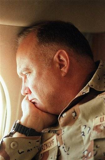 In this Jan. 13, 1991 file photo, General H. Norman Schwarzkopf, commander of U.S. troops in the Gulf, gazes from the window of his small jet on his way out to visit U.S. troops in the desert in Saudi Arabia.Schwarzkopf died Thursday in Tampa, Fla. He was 78.