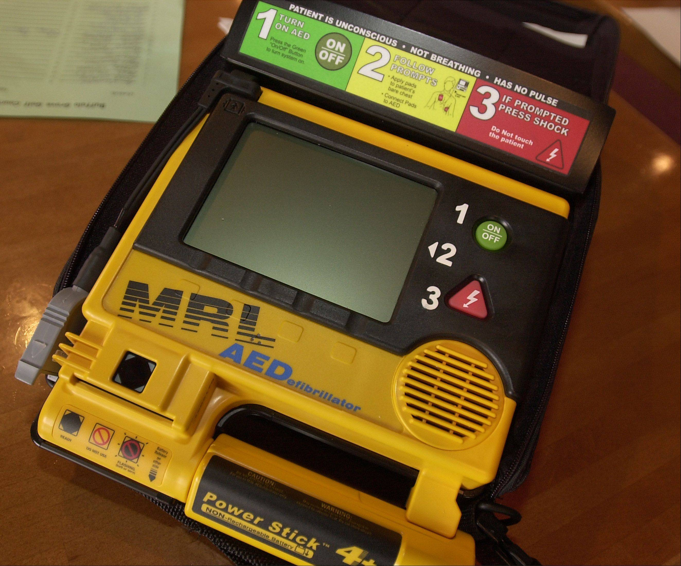 Automated external defibrillators like this one have become cheaper and easier to use. Now Metra will install defibrillators on every train.