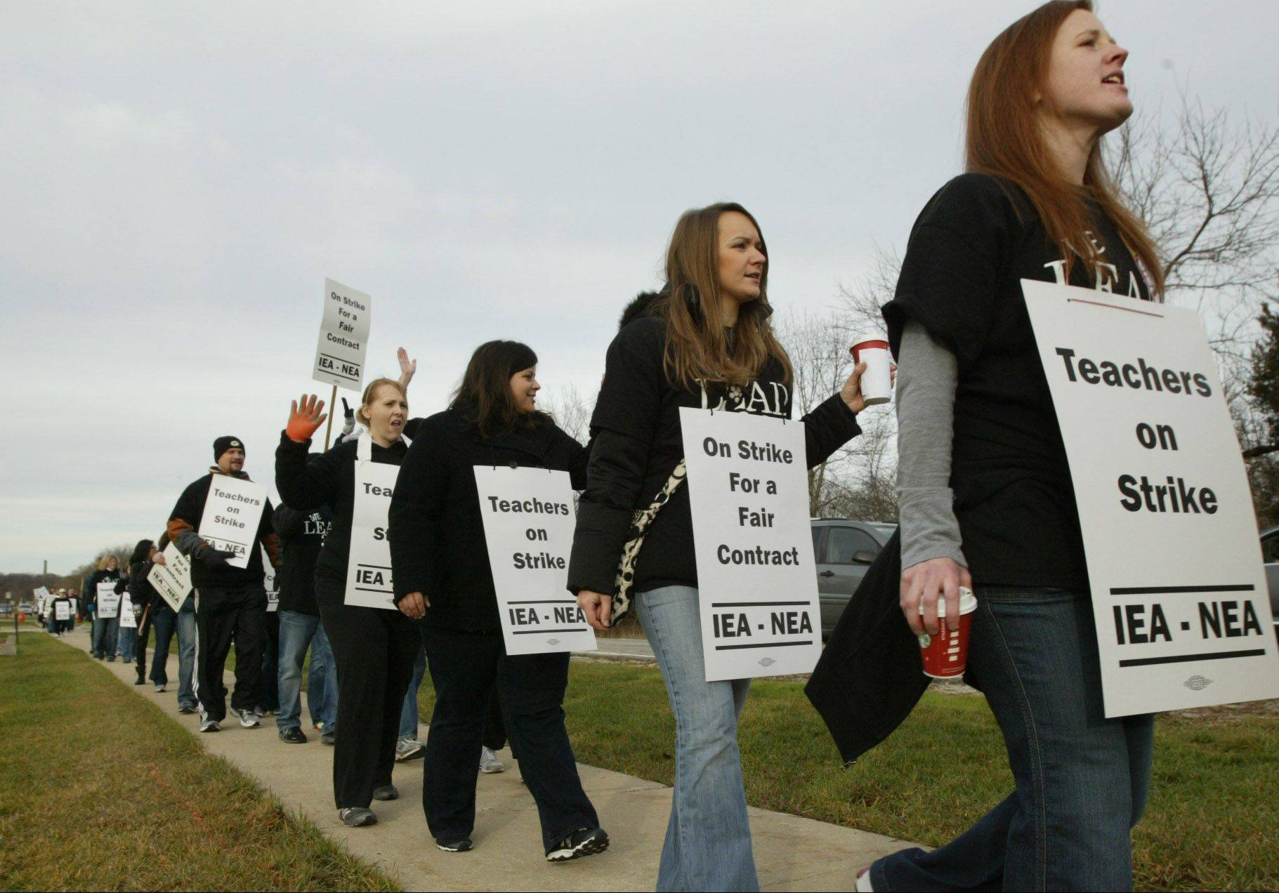 Community Unit District 300 teachers walk the picket line outside district headquarters after the teachers union went on strike Dec. 4. The strike only lasted for a day and teachers were able to ink a tentative agreement with the school district.