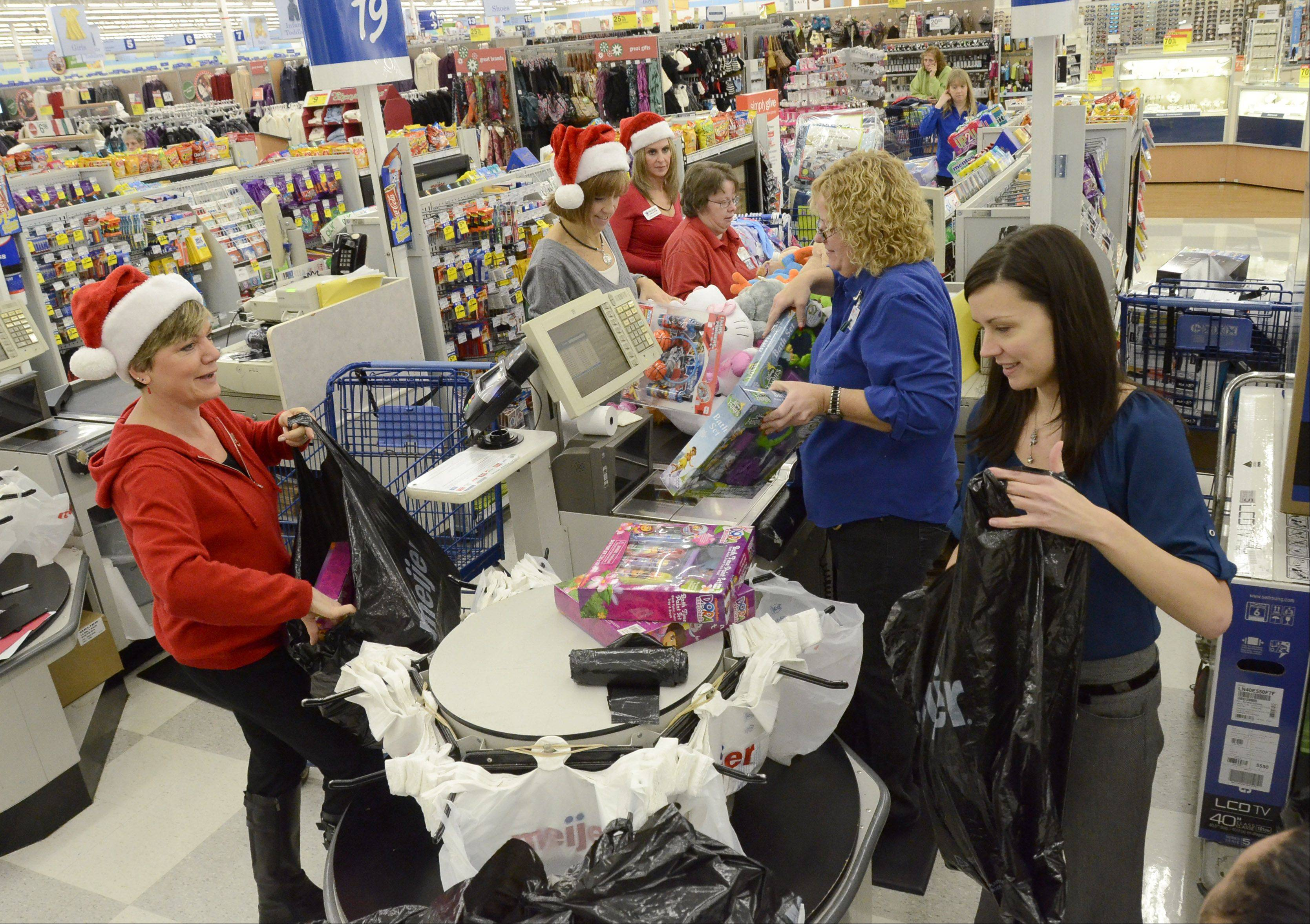 Santa's helpers from the Daily Herald load up toys for the Hope for the Holidays campaign at the Meijer store in Rolling Meadows.